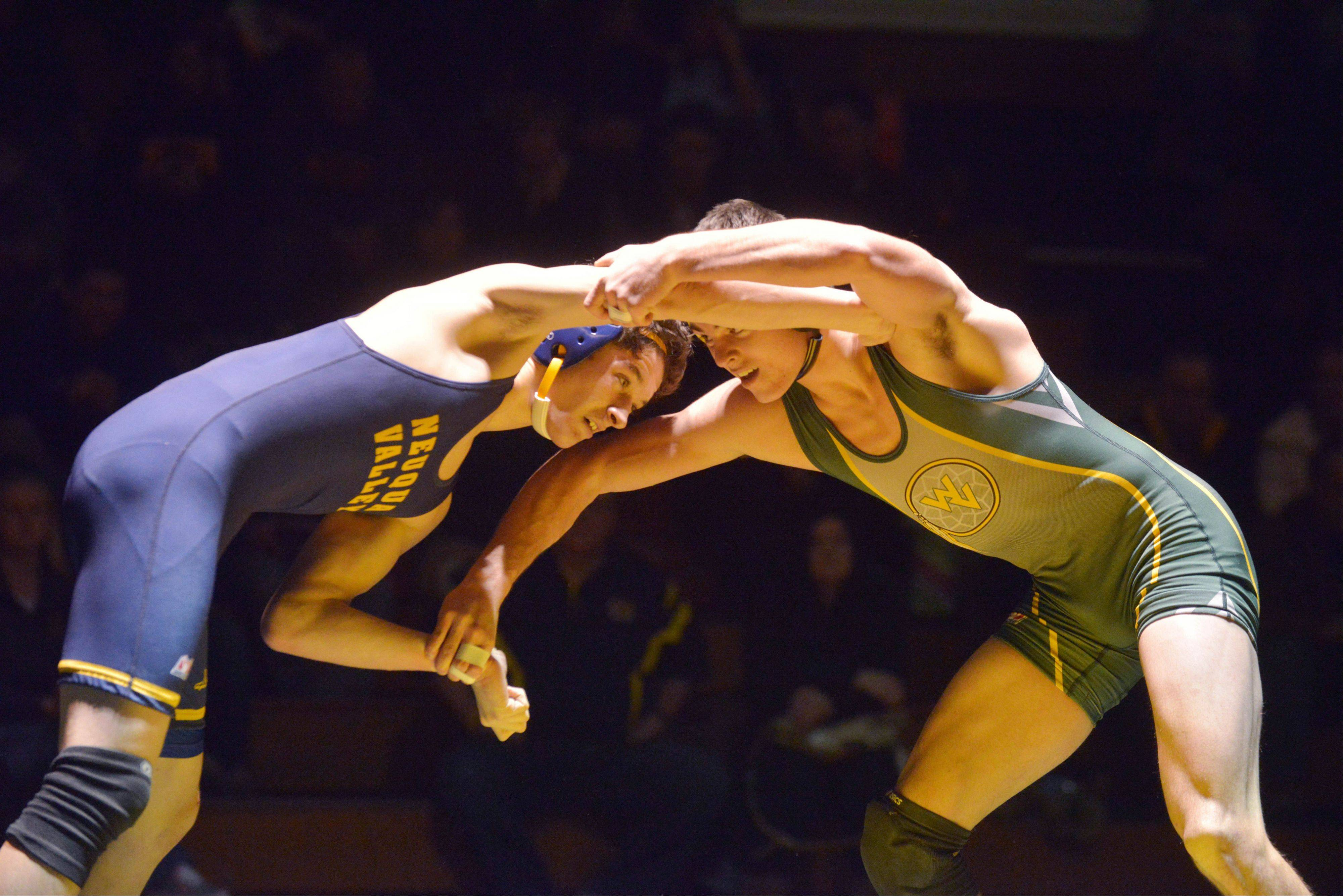 Paul Michna/pmichna@dailyherald.com Jackson Modaff of Neuqua and Jimmy Davis of Waubonsie Valley take part in the 138 pound match during the Neuqua Valley at Waubonsie Valley wrestling meet Friday.