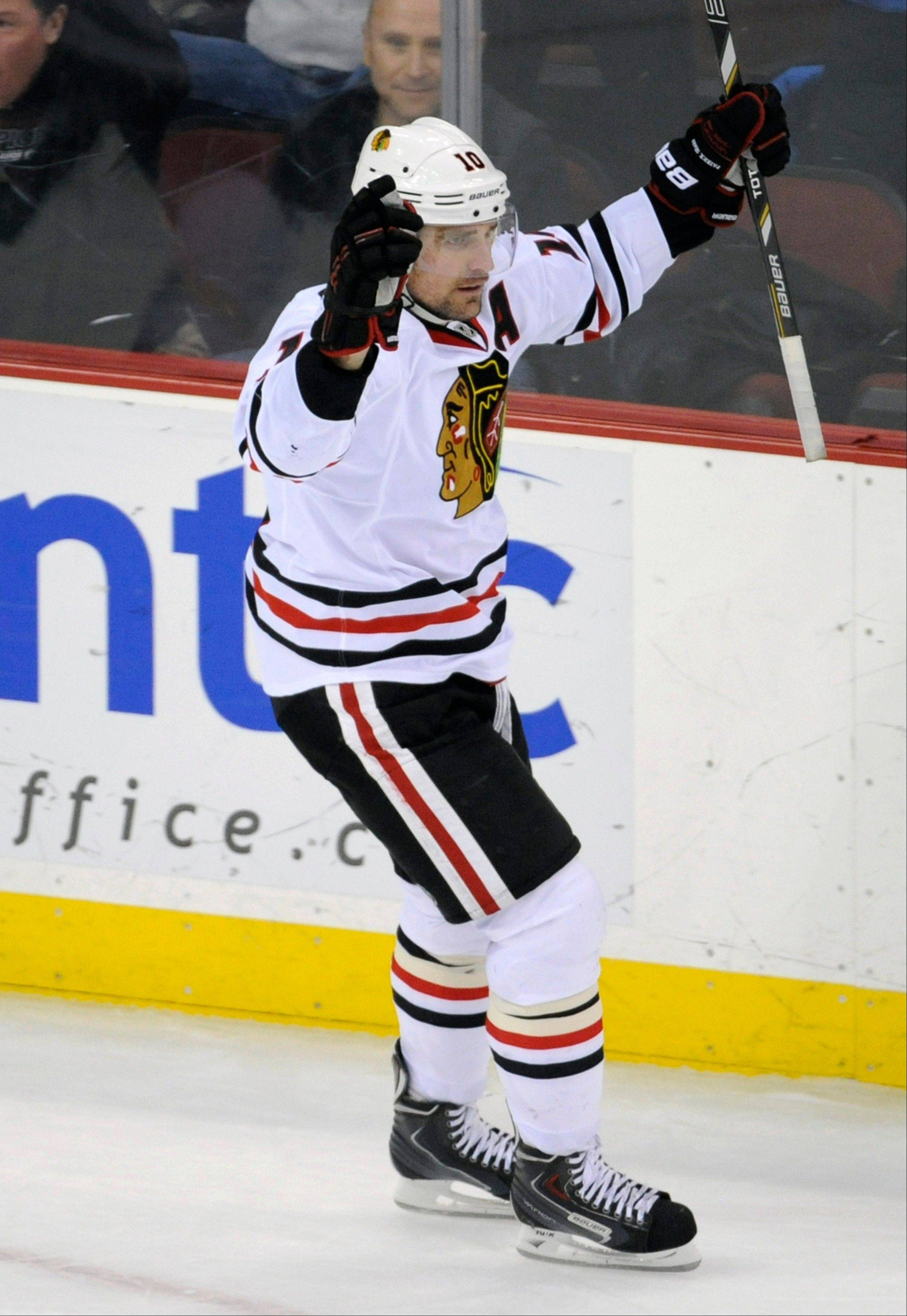 The Blackhawks� Patrick Sharp celebrates his fourth career hat trick and second in his last five games. The red-hot Sharp has 14 goals in his last 13 games.