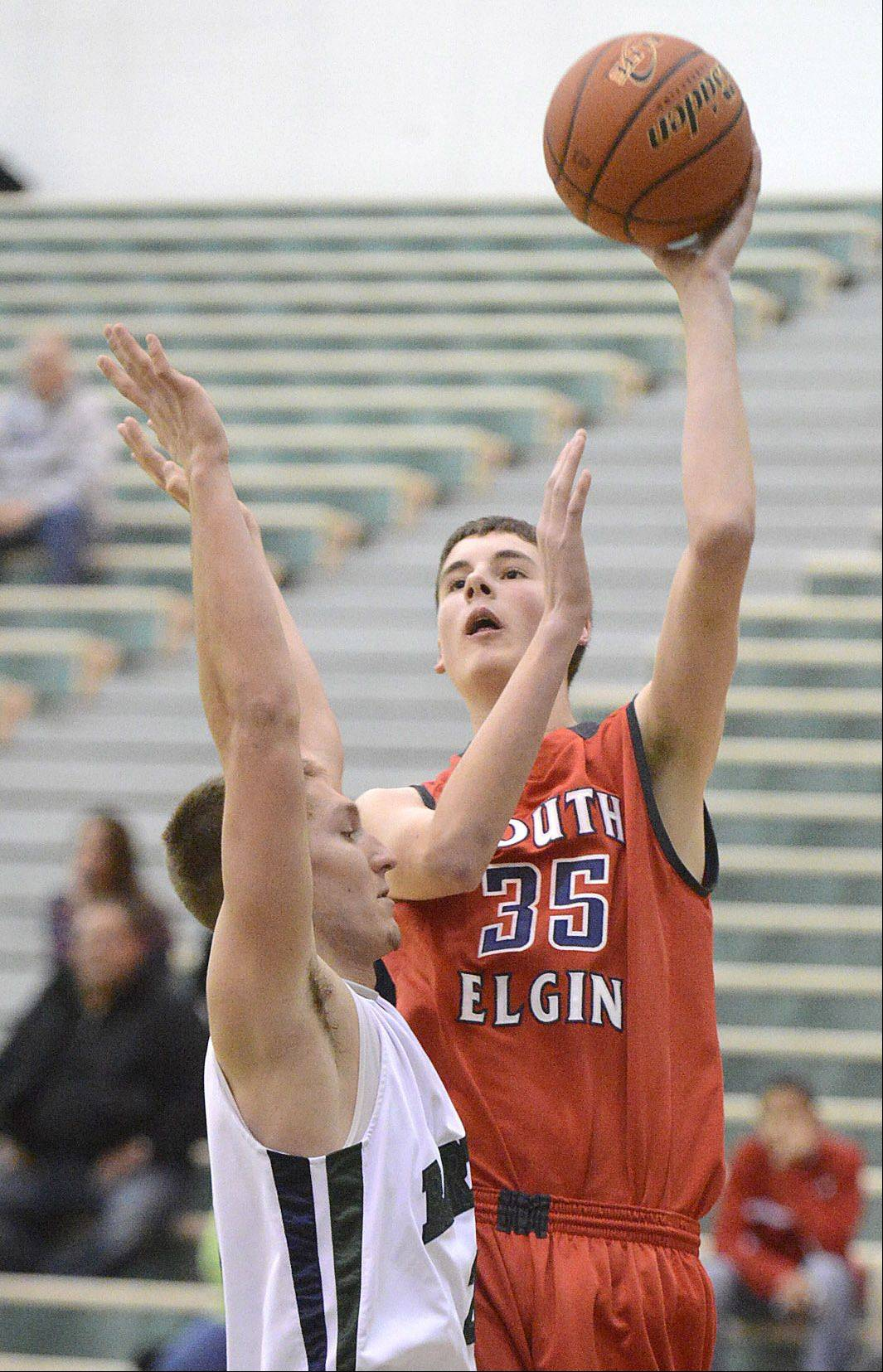 Tyler Hankins, here shooting against Bartlett�s Brian Triphahn, helped South Elgin finish up with a four-game win streak in Hinkle Holiday Classic play at Jacobs.