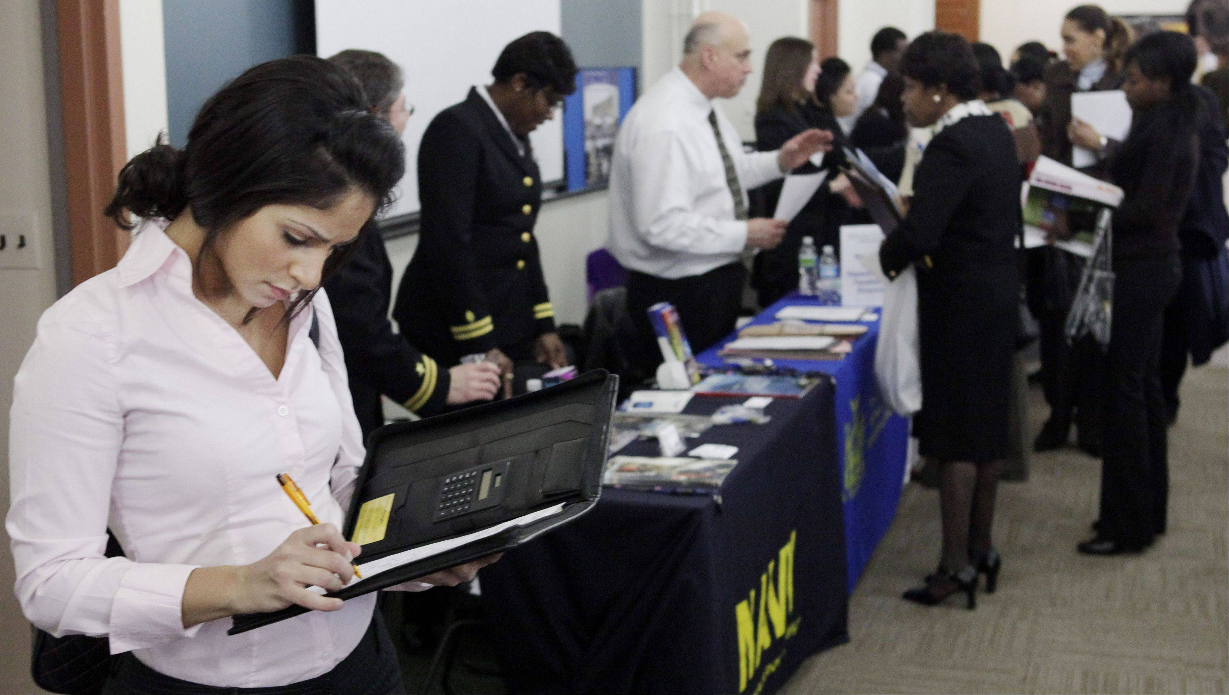 Job seekers at a job fair at Roosevelt University in Chicago. University of Illinois economist Fred Giertz said the state's economy finished the year strong in spite of stubbornly high unemployment.