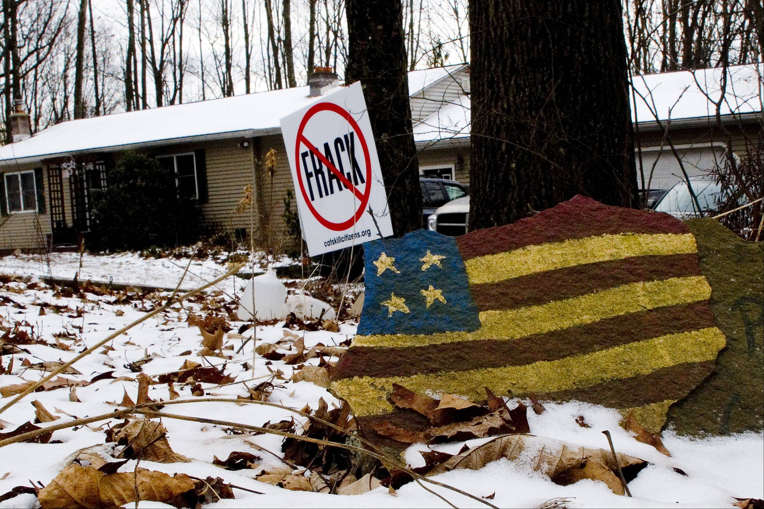 Yard signs to protest the hydraulic fracturing of gas wells are seen at the home of Craig and Julie Sautner in Dimock, Pa.
