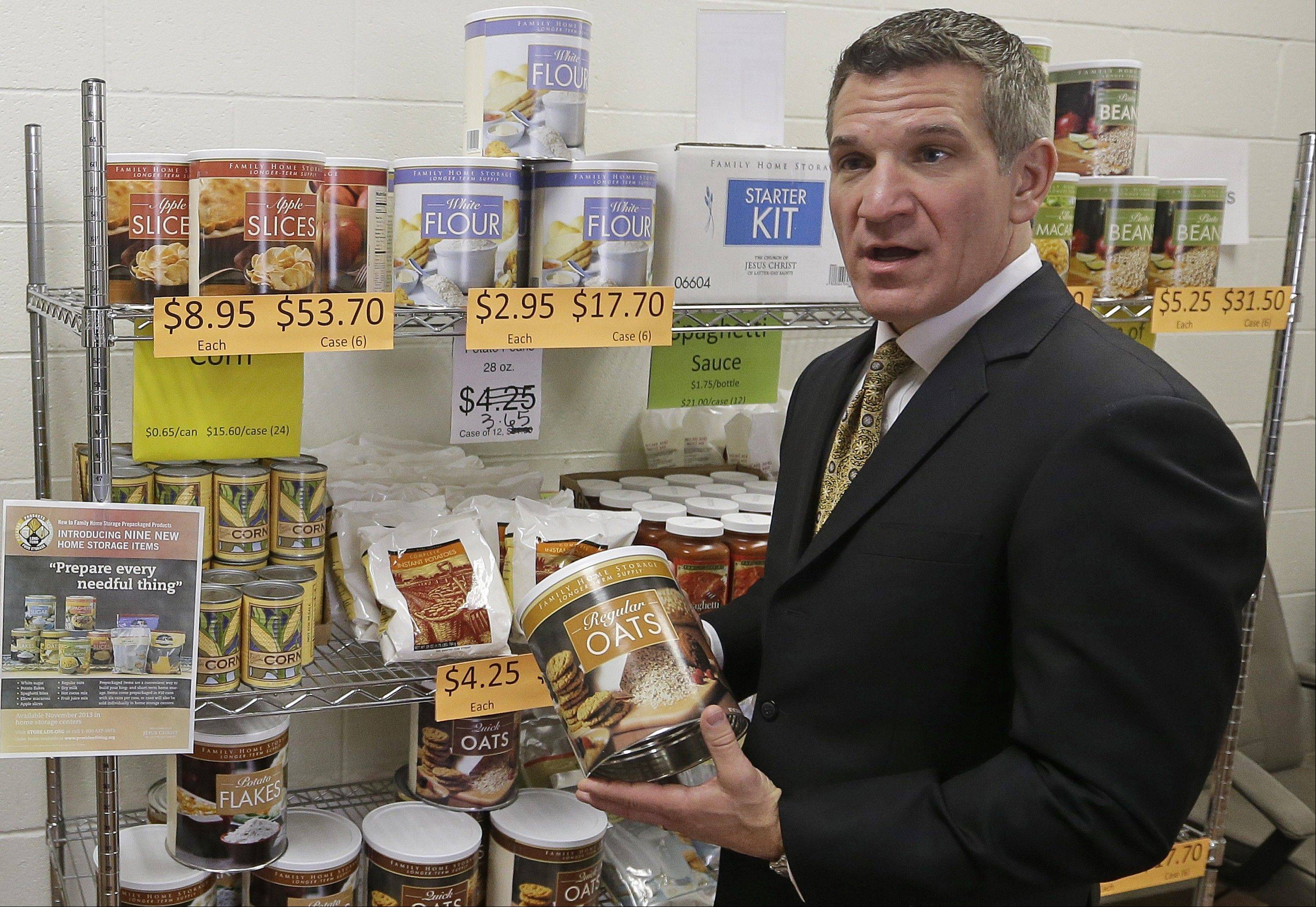 Rick Foster, manager of North America Humanitarian Services with the Church of Jesus Christ of Latter-day Saints, talks about the Mormon Church's Welfare Square in Salt Lake City, where people can buy large cans and bags of oats, wheat, sugar, potato flakes and beans. Many Mormons buy items from this center as they compile a three-month supply of food, while also storing away food that can last as long as 30 years.