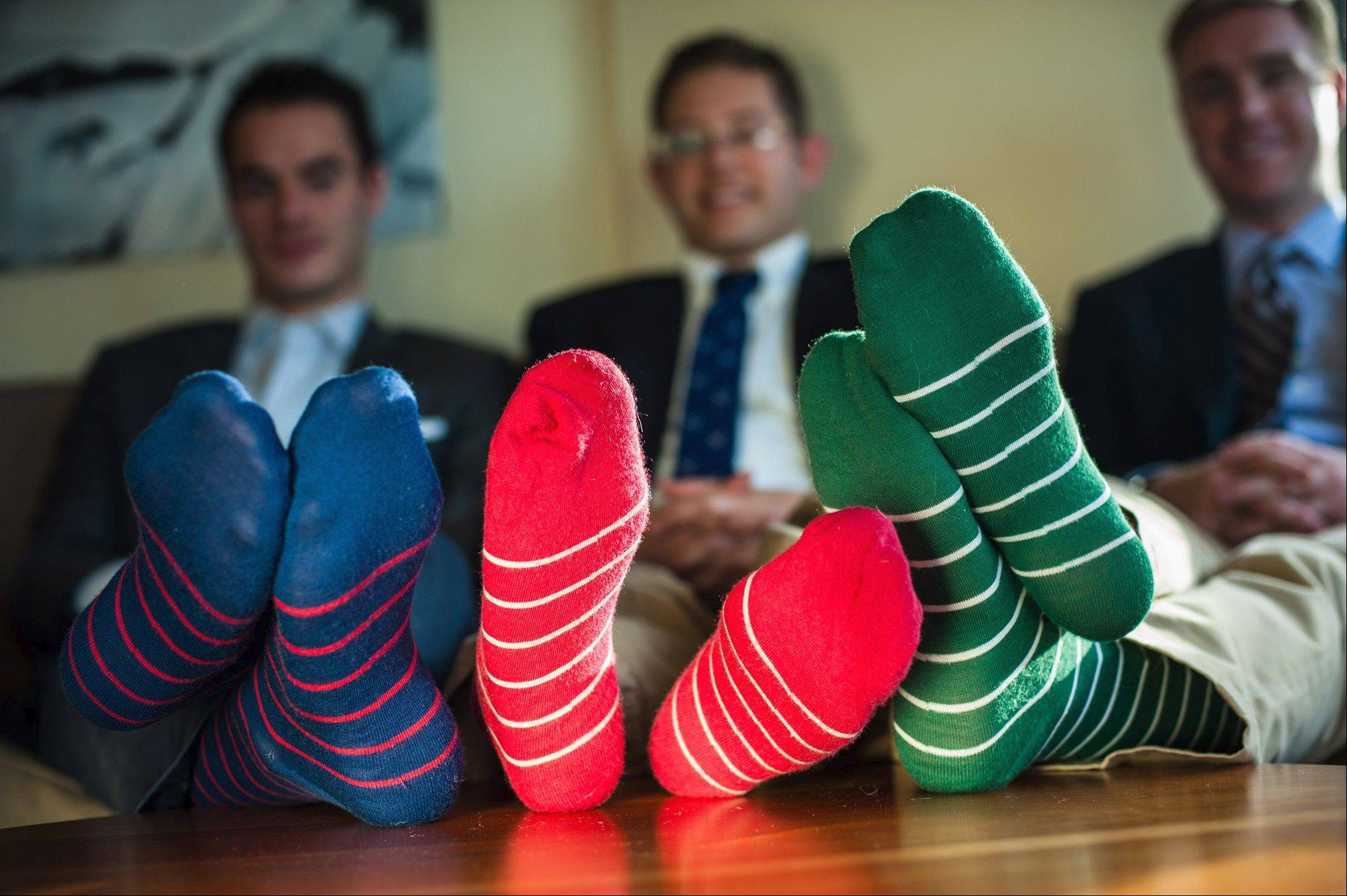 Friends and federal workers, Turner Swicegood, left, Joshua Steinman and Jay Gaul are co-owners of Penance Hall, a startup producing luxury men's socks.