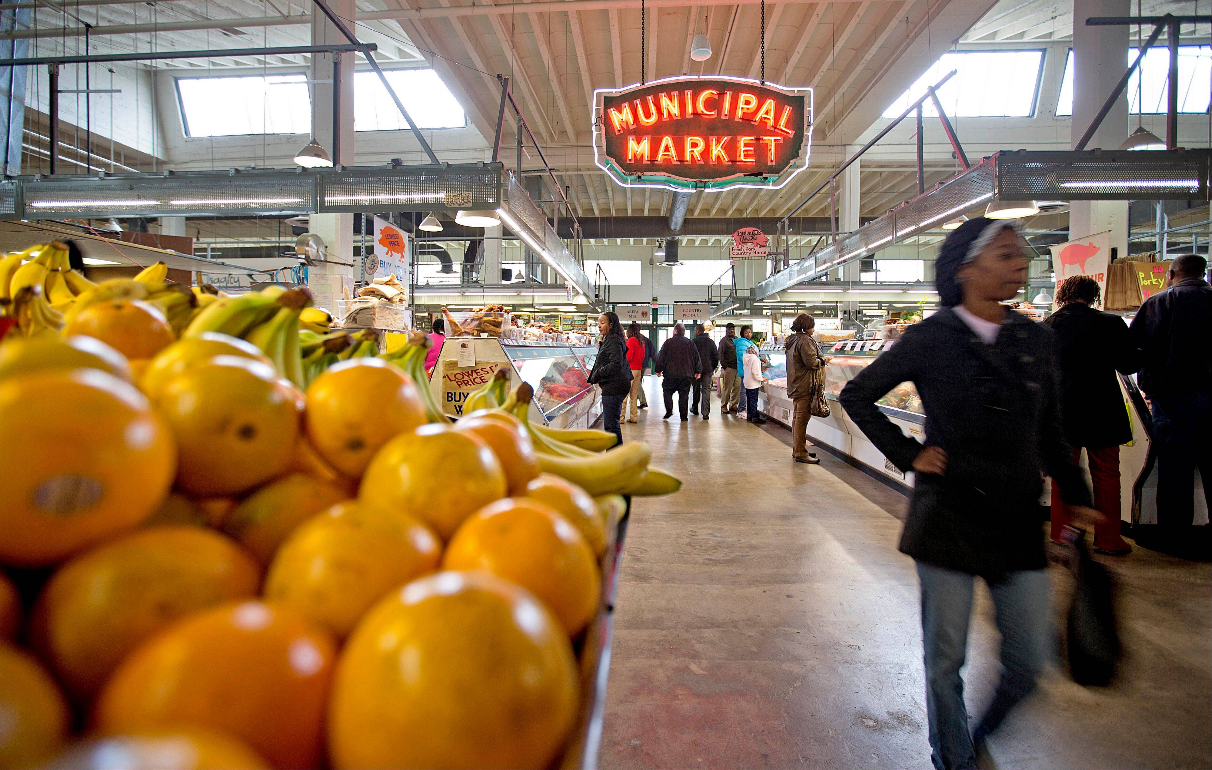 Shoppers pass through the Sweet Auburn Curb Market in Atlanta, which is now an urban farmers market that provides a lively atmosphere for browsing and grabbing lunch.