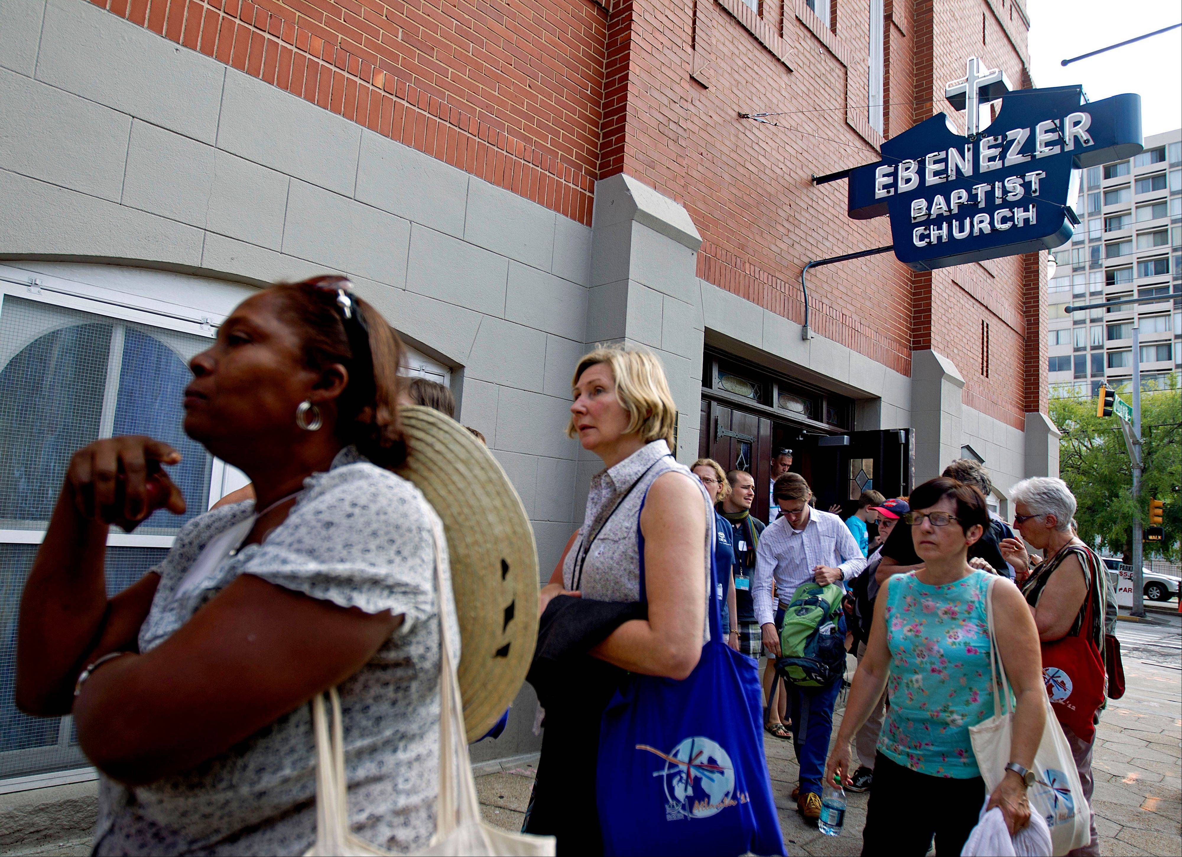 Tourists visit the Ebenezer Baptist Church where Rev. Martin Luther King Jr. preached in Atlanta.