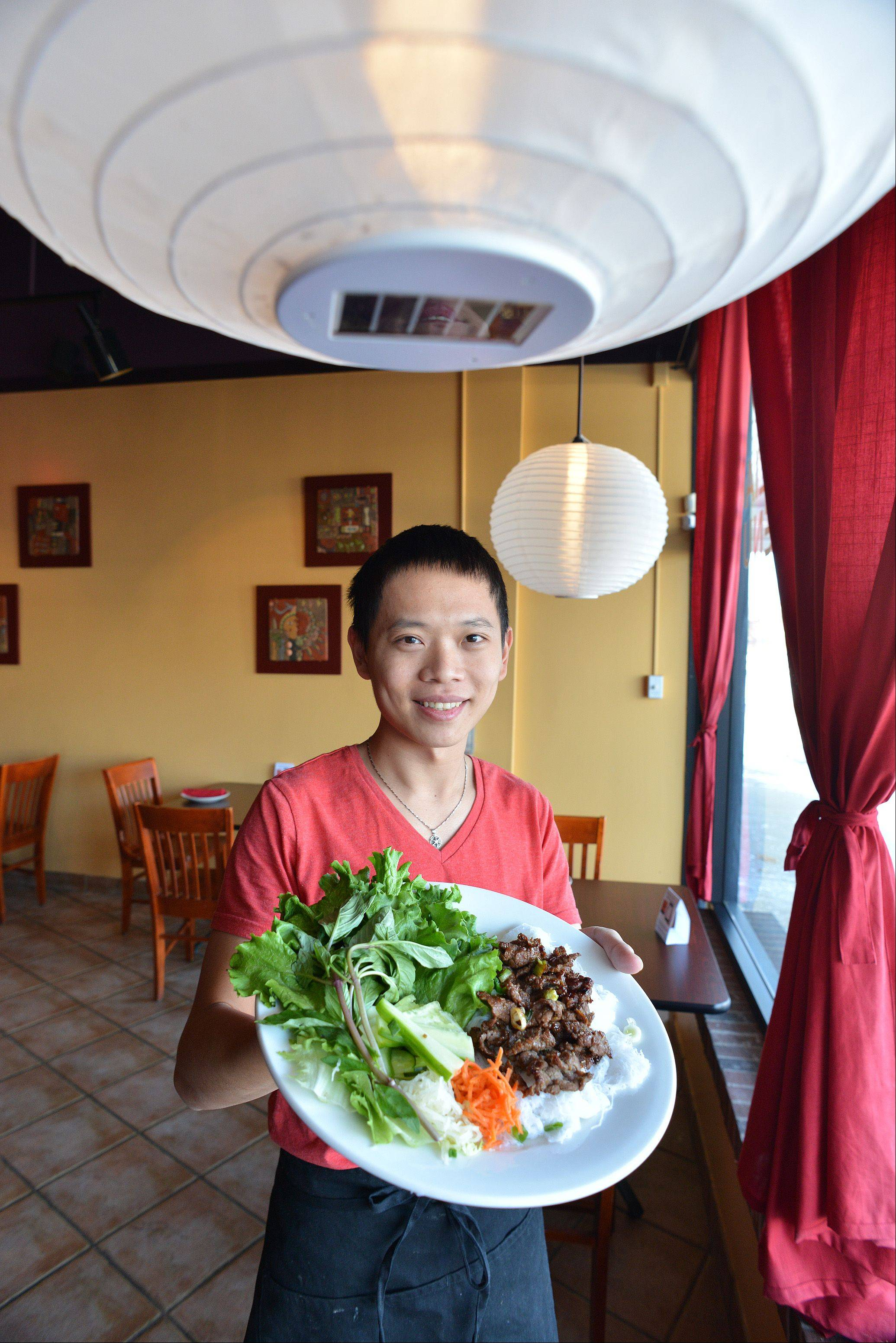 Cuisine de Saigon chef/owner Chan Le shows off the banh hoi thit nuog.