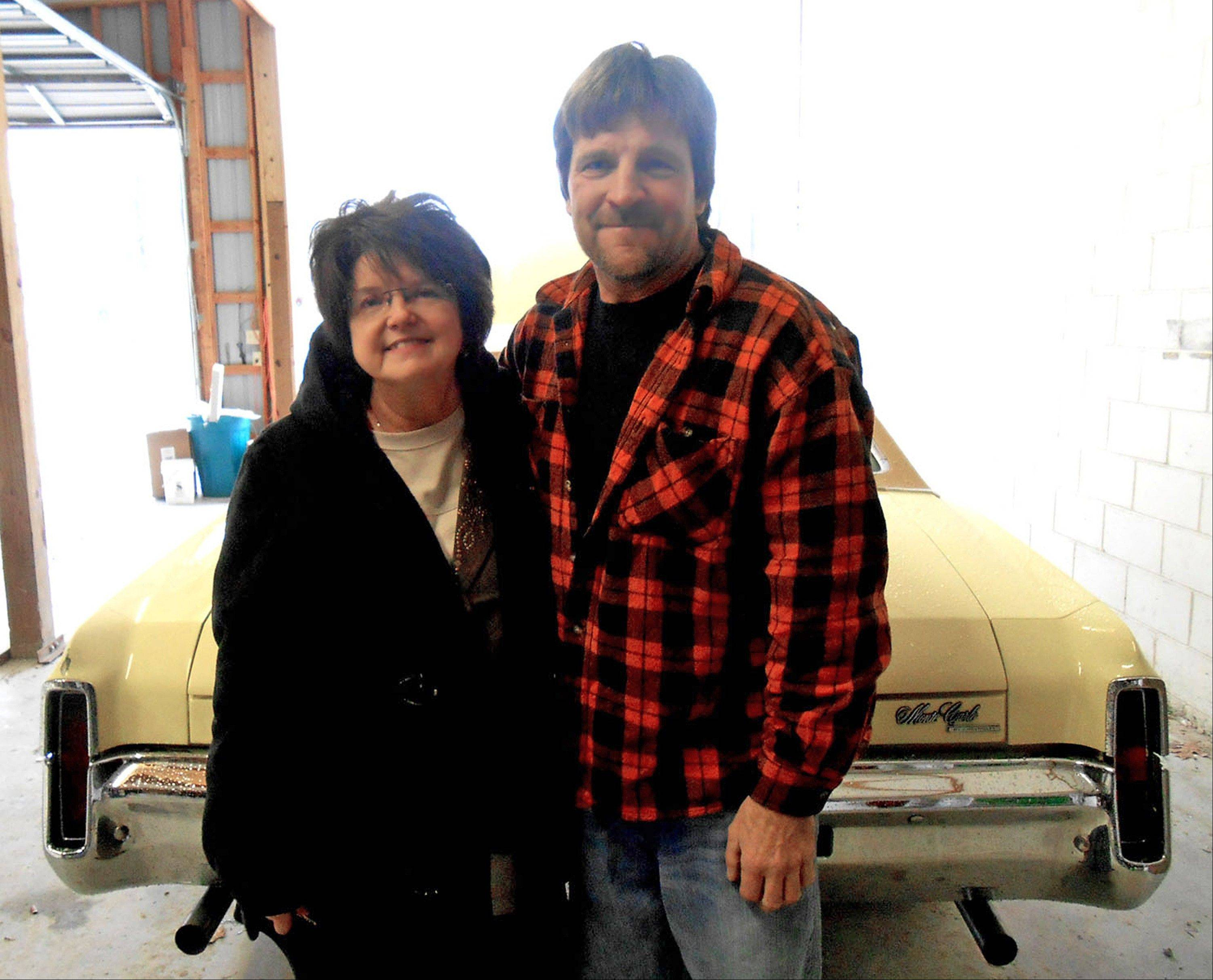 Cathy Henderson and Kevin Pocrnich will sell at auction this 1970 Chevrolet Monte Carlo that many in the Effingham community helped restore recently for Cathy's late husband, Ron Henderson, who died of cancer.