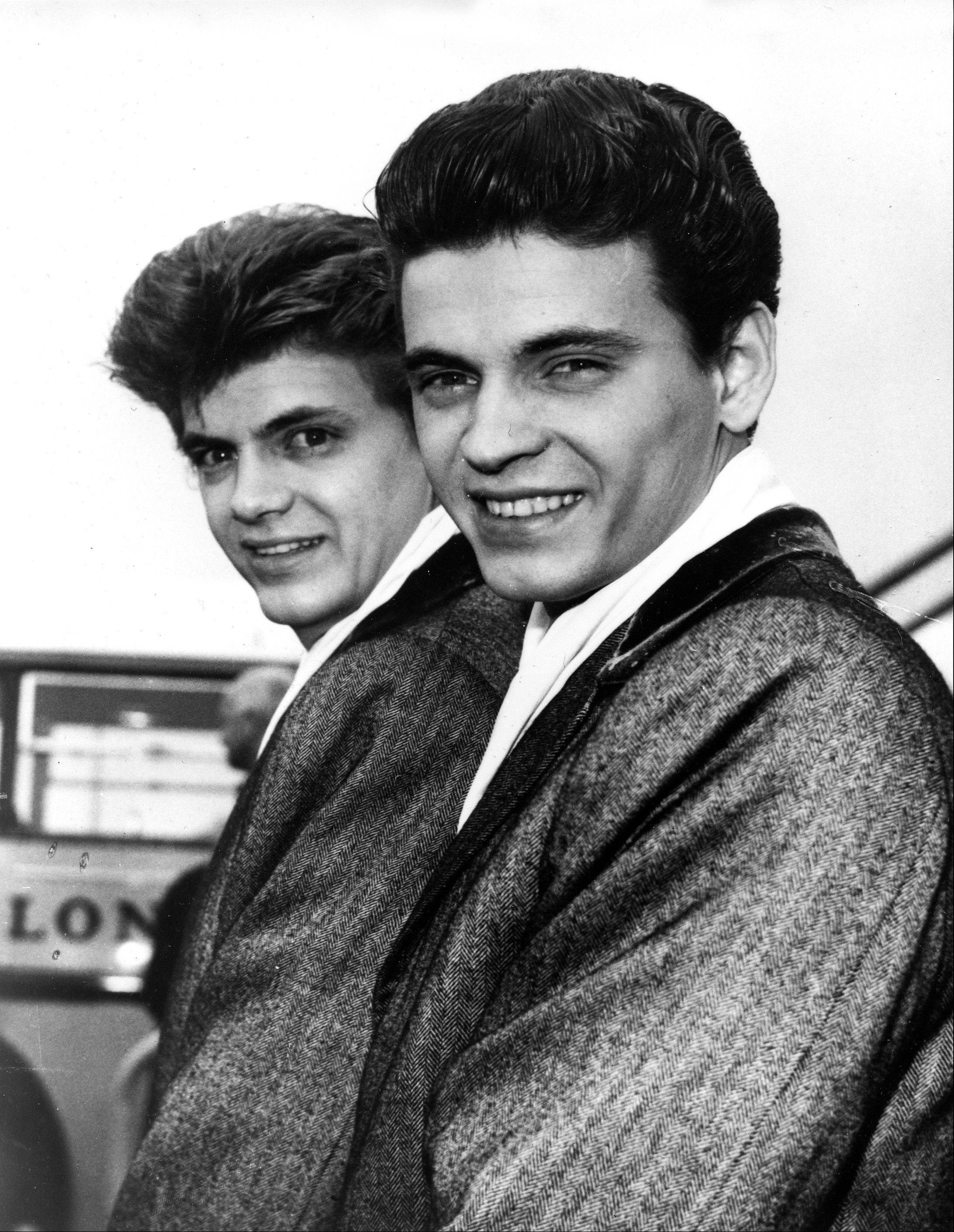 In this April 1, 1960 file photo, Phil, left, and Don of the Everly Brothers arrive at London Airport from New York to begin their European tour. Everly, who with his brother Don formed an influential harmony duo that touched the hearts and sparked the imaginations of rock 'n' roll singers for decades, including the Beatles and Bob Dylan, died Friday, Jan. 3, 2014. He was 74. Everly died of chronic obstructive pulmonary disease at a Burbank hospital, said his son Jason Everly.