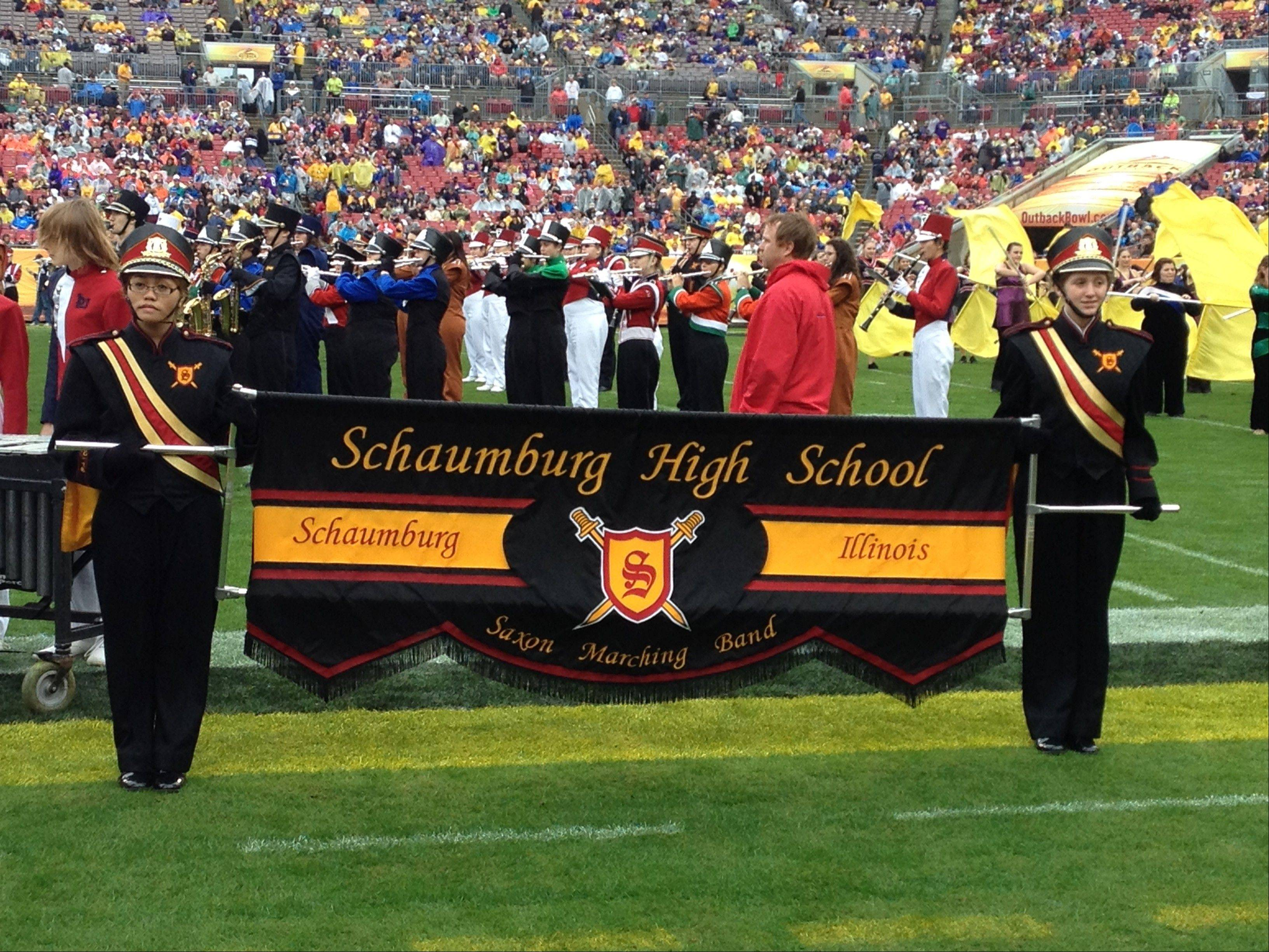 The Schaumburg High School marching band performs during halftime at the Outback Bowl in Florida.