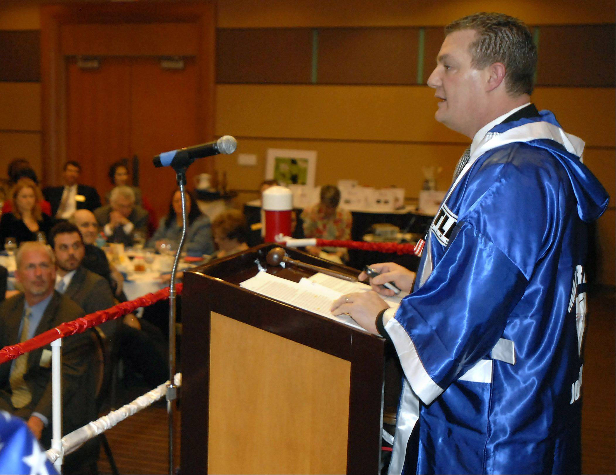 Dr. Joseph Favia speaks at the Arlington Heights Chamber of Commerce installation and recognition celebration in 2010 when he was president of the group. The robe was given to him because the event had a boxing theme.