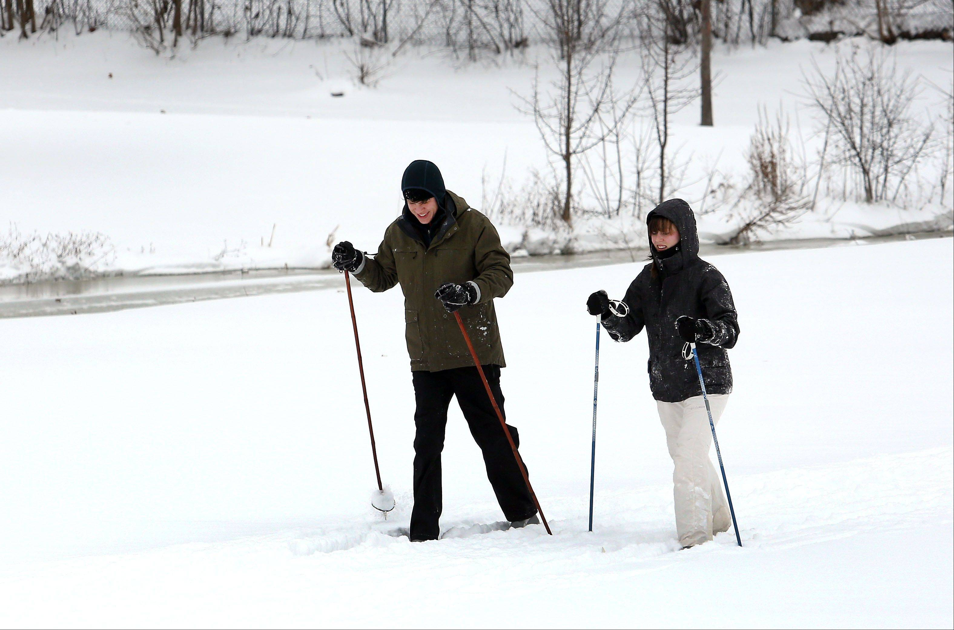 Nick Siaglia, left, of Roselle and Sarah Bopp of Bloomingdale do some cross country skiing Friday at Bloomingdale's Circle Park.