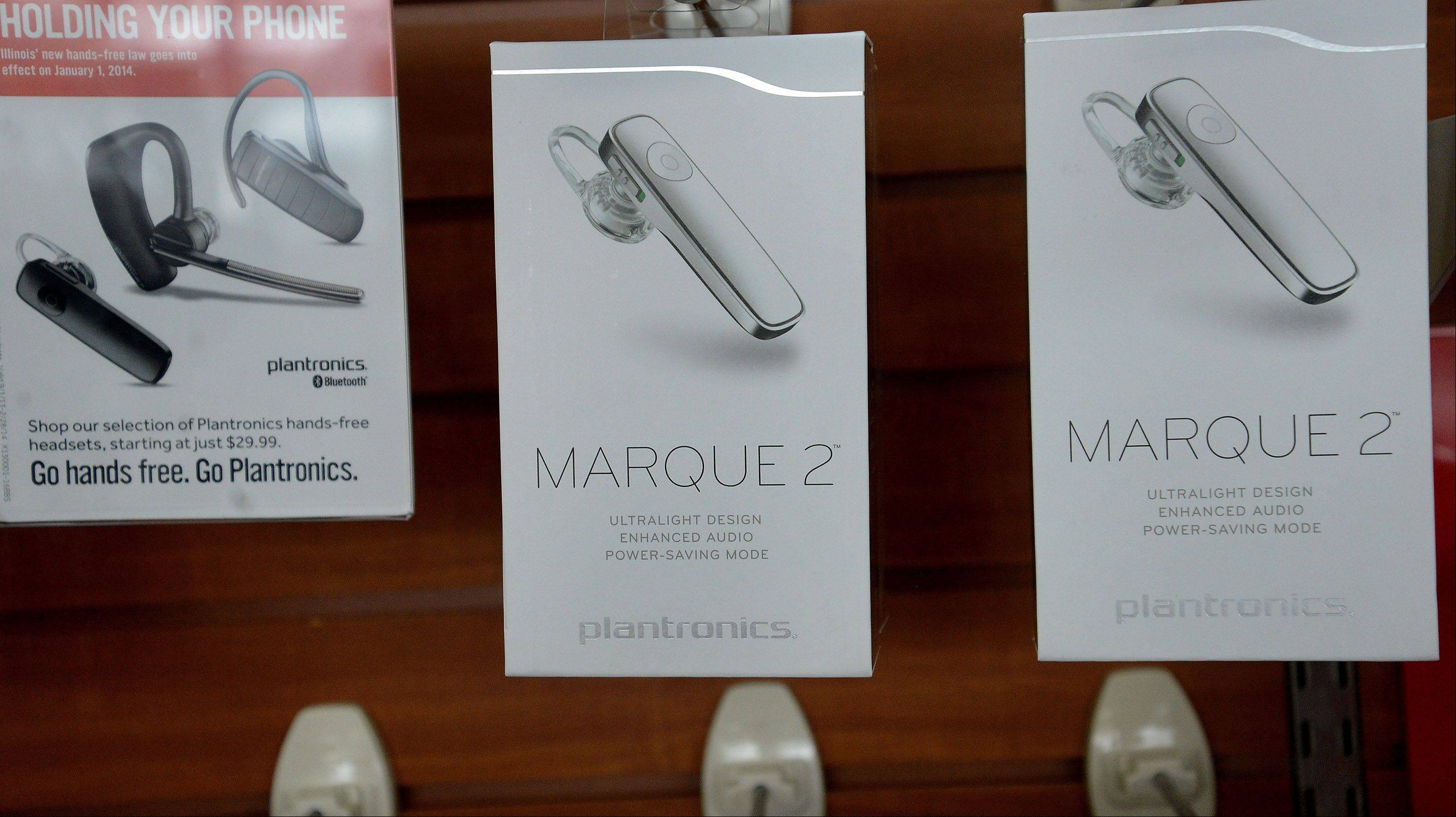 The Plantronics Marque 2 is a popular Bluetooth earphone device these days in suburban electronics and telecommunications stores. As of New Year's Day, talking on a cellphone behind the wheel without a hands-free device is forbidden in Illinois.