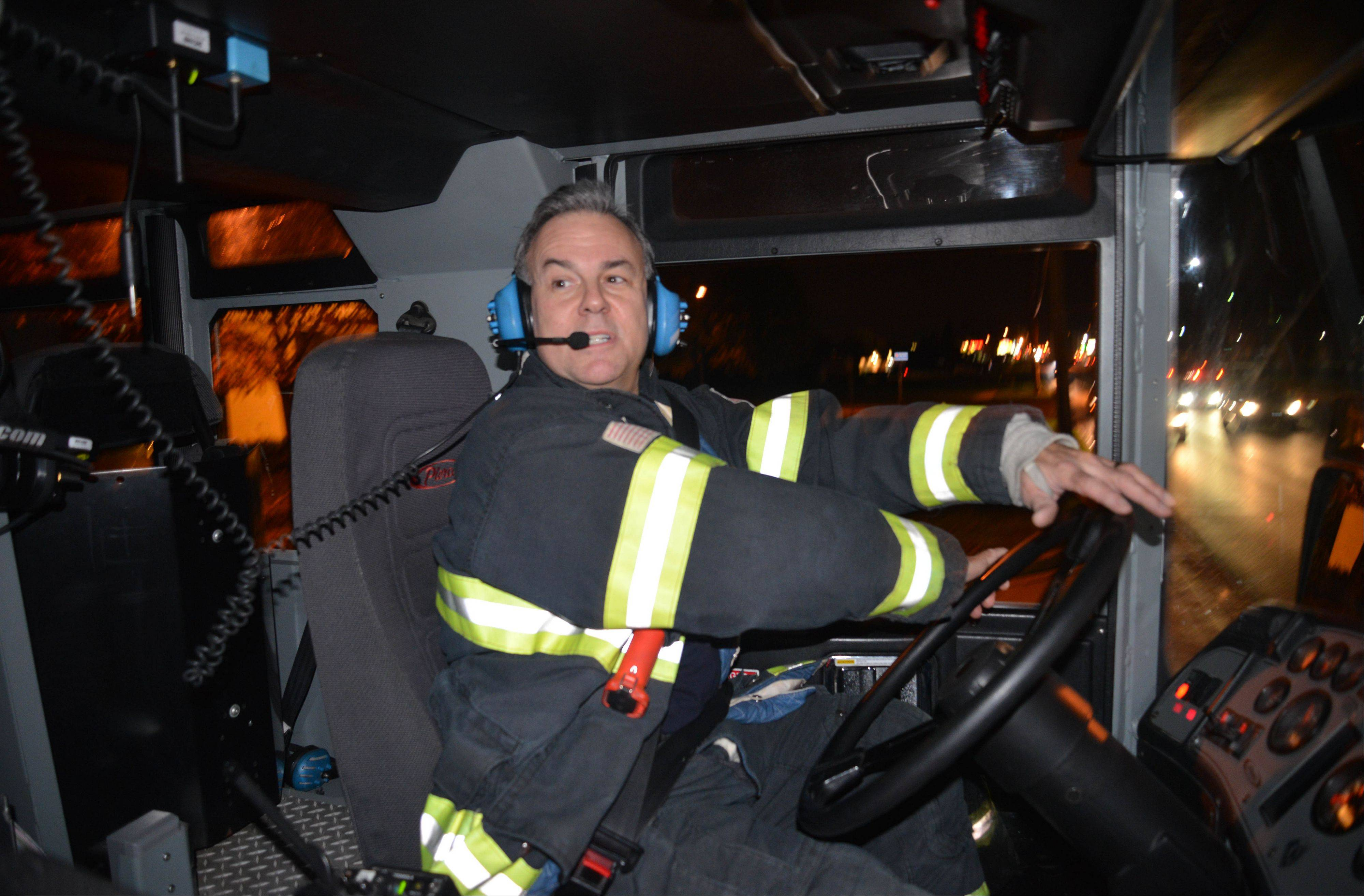 Dan Sullivan drives one of the department rigs from the Westmont Fire Station during a recent night on shift.