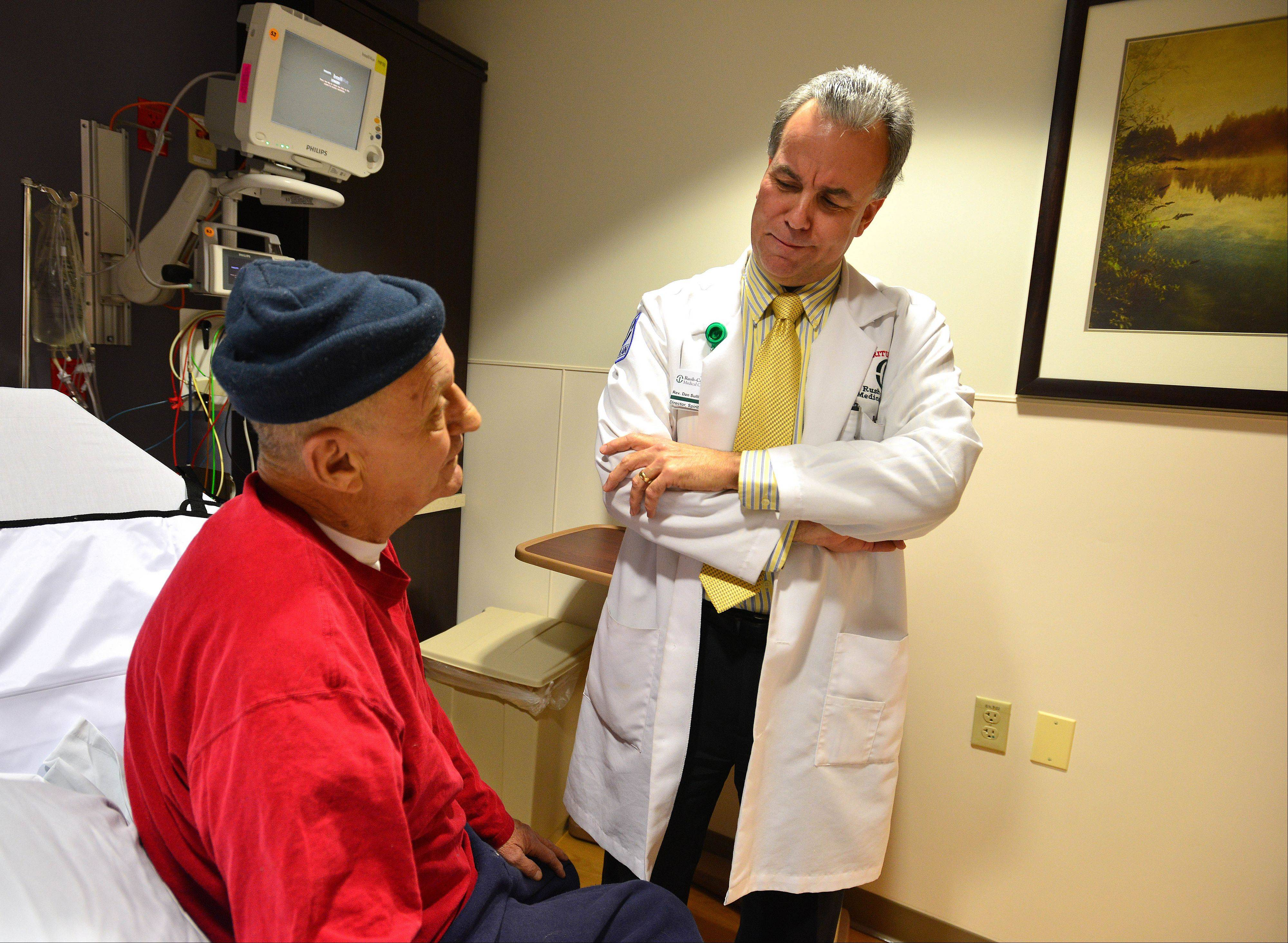 Ray Estes, left, of Aurora chats with Dan Sullivan before being released from Rush-Copley Medical Center in Aurora.
