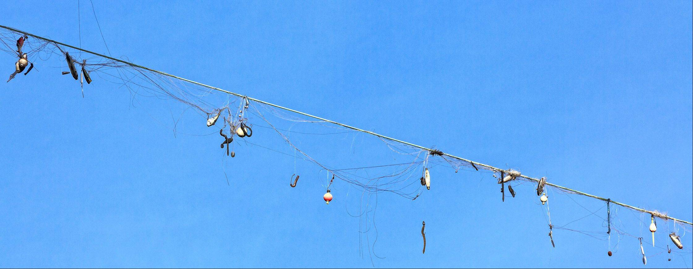 This is a bunch of fishing lures and lines tangled on a telephone wire at Lake Johnson Park in Raleigh, North Carolina on December 29th.