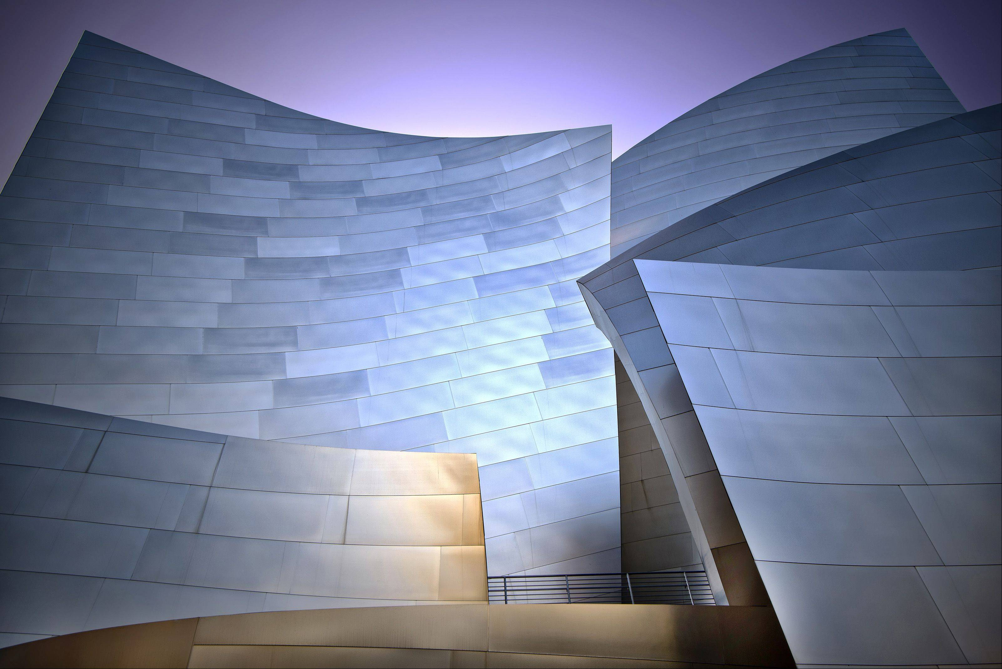 This is The Walt Disney Concert Hall is in Los Angeles. It's an intriguing metallic structure with lots of surfaces and angles. It is also the home of the Los Angeles Philharmonic Orchestra.