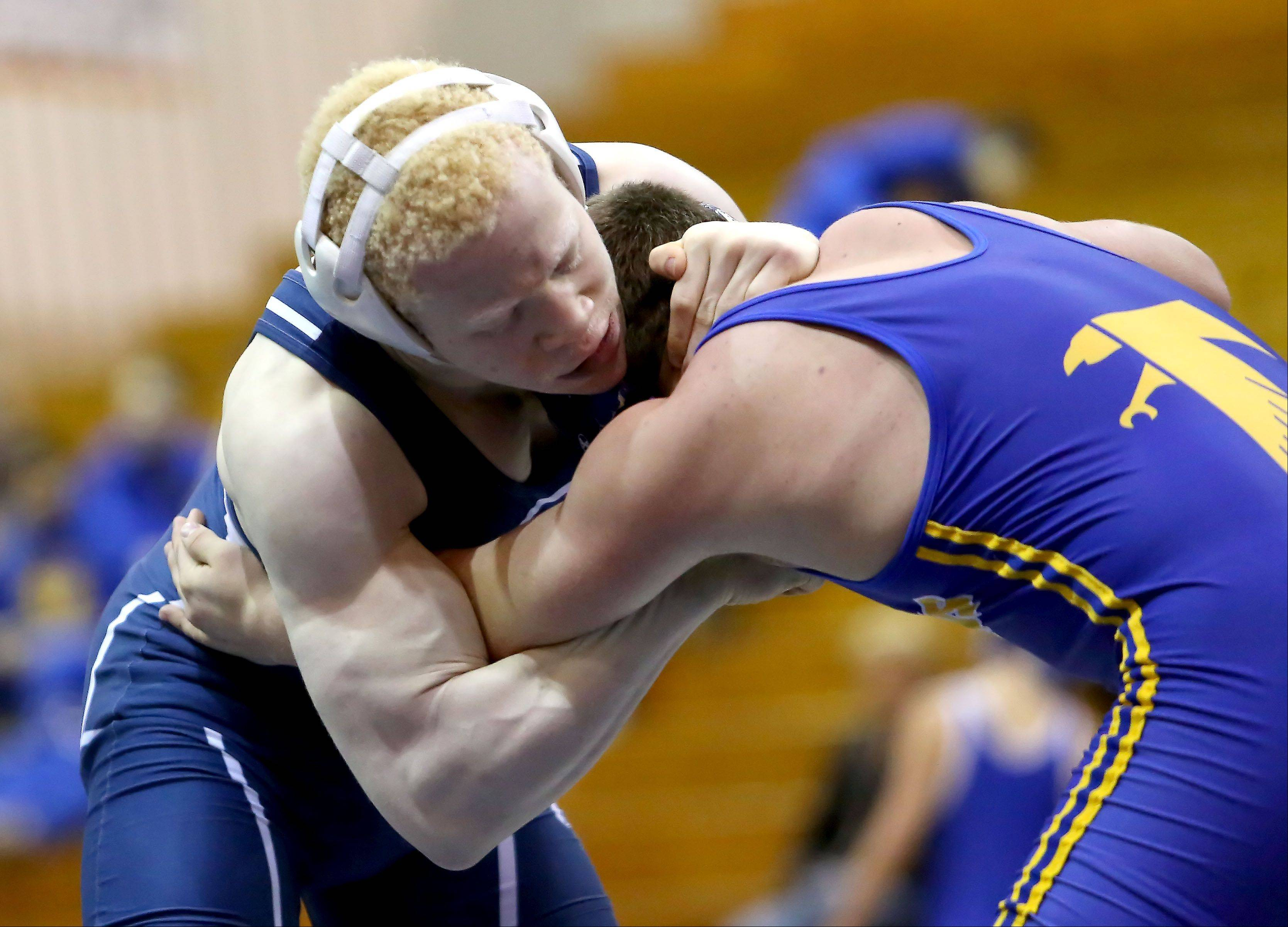 Addison Trail's Stephan Hayden, left, wrestles Wheaton North's George Roskuszka in a 170lb match on Friday in Addison.