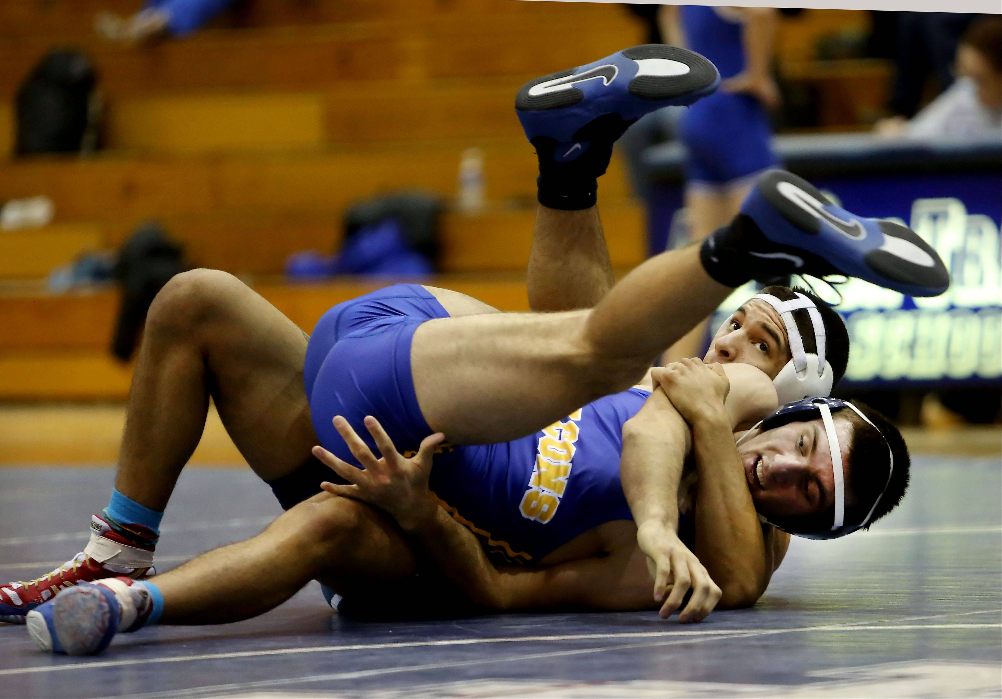 Addison Trail's Niko Rocha, right, wrestles Wheaton North's Costaki Danegelis in a 182lb match on Friday in Addison.