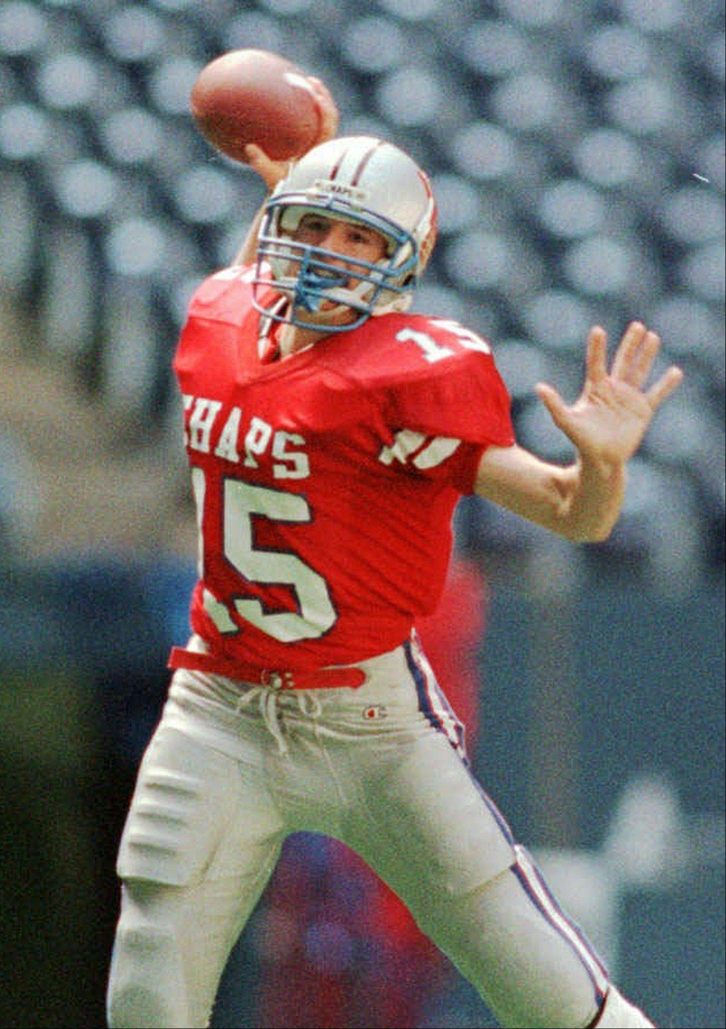This Dec. 21, 1996 file photo shows Westlake High School quarterback Drew Brees preparing to pass against Abilene Cooper High School during a game in Austin, Texas. Ten years after Brees led Westlake High School to victory in the Texas state championship game, Nick Foles broke several of his passing records but lost in the title game. The two quarterbacks meet in an NFC wild-card game on Saturday.