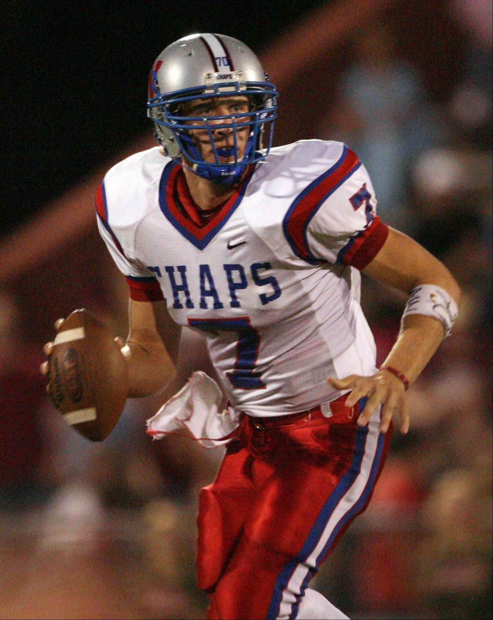 This Sept. 29, 2006 photo shows Westlake High School quarterback Nick Foles looking for a receiver against Austin High during a game in Austin, Texas. Ten years after Drew Brees led Westlake High School to victory in the Texas state championship game, Foles broke several of his passing records but lost in the title game. The two quarterbacks meet Saturday with far more at stake in an NFC wild-card game between the Saints and the Eagles.