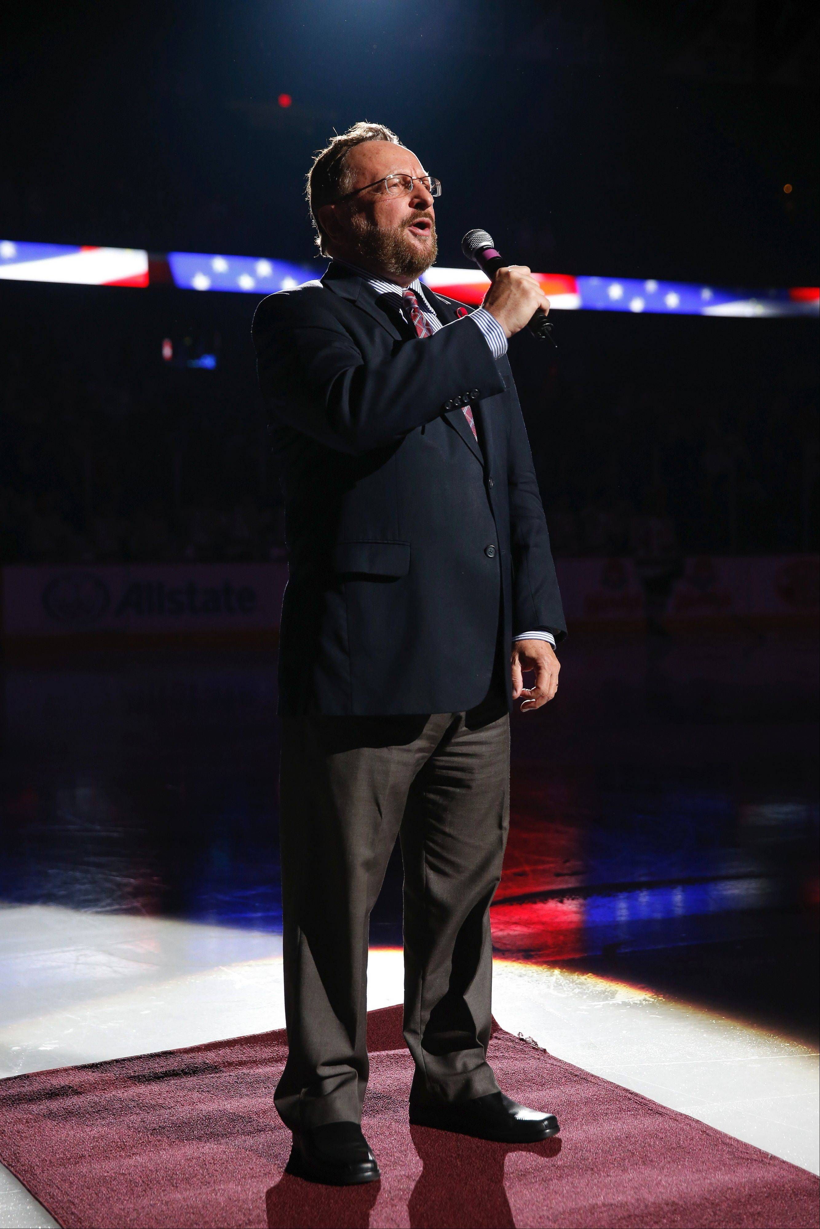 Wolves executive Wayne Messmer, shown here singing the national anthem before a hockey game at Allstate Arena, was saved by first responders nearly 20 years ago after he was shot in Chicago. This weekend the Wolves and Messmer will honor first responders and raise funds for their charities.