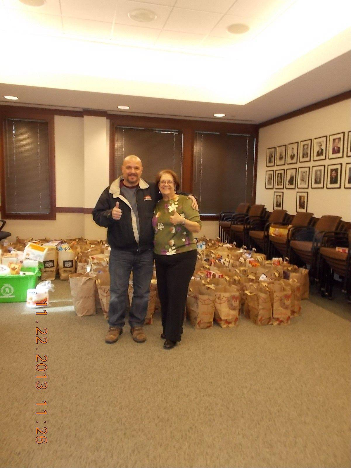 Joe Coriaci, owner of Servpro of Arlington Heights/Prospect Heights with Carol Jancek, from the village of Arlington Heights, where the food was delivered and sorted for delivery to families in need.