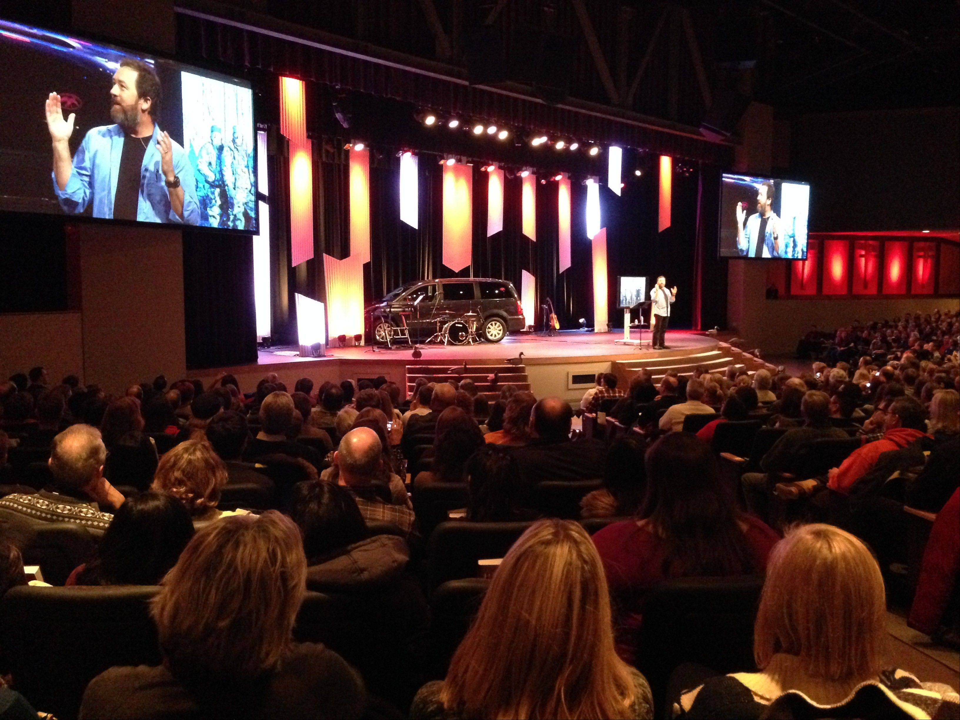 �Duck Dynasty� star Alan Robertson speaks to a packed house Saturday night at Compass Church in Naperville.