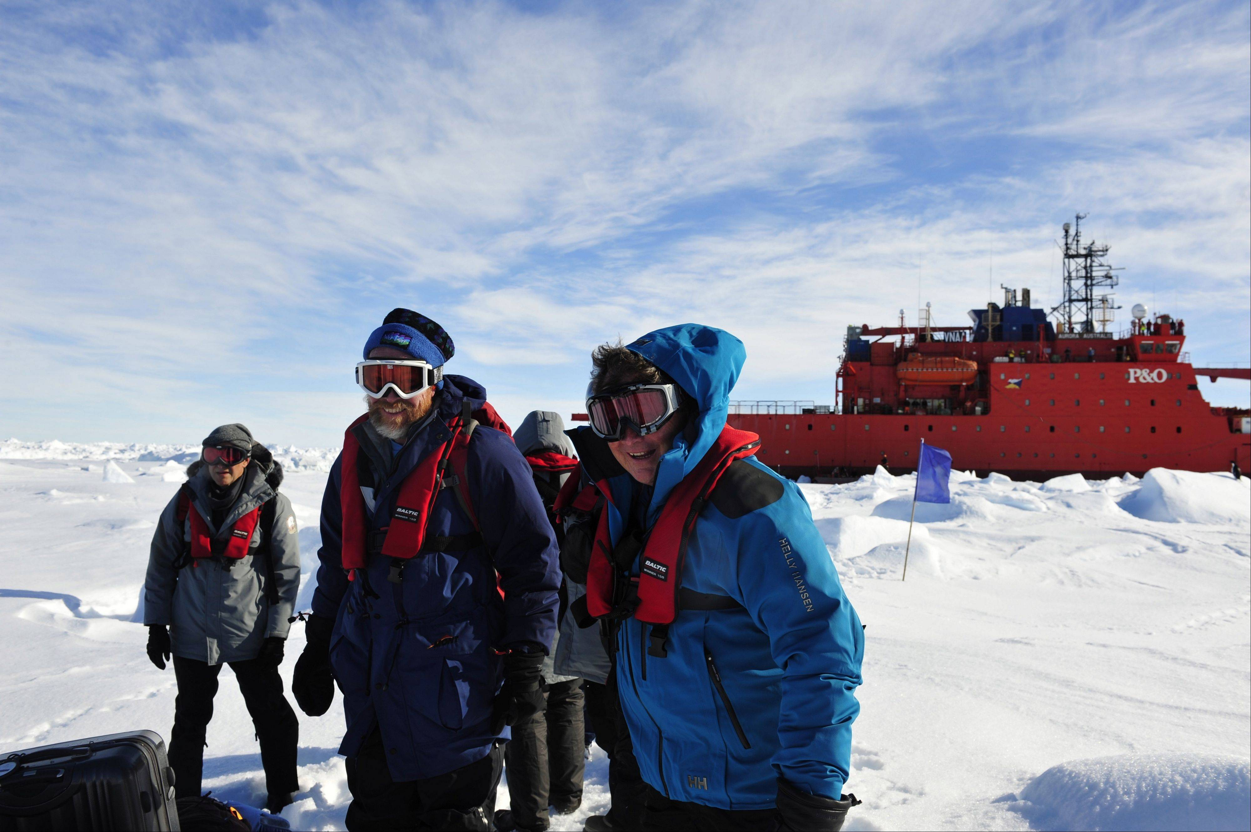 The first group of passengers aboard the trapped Russian ship MV Akademik Shokalski arrive at a safe surface Thursday off the Antarctic.