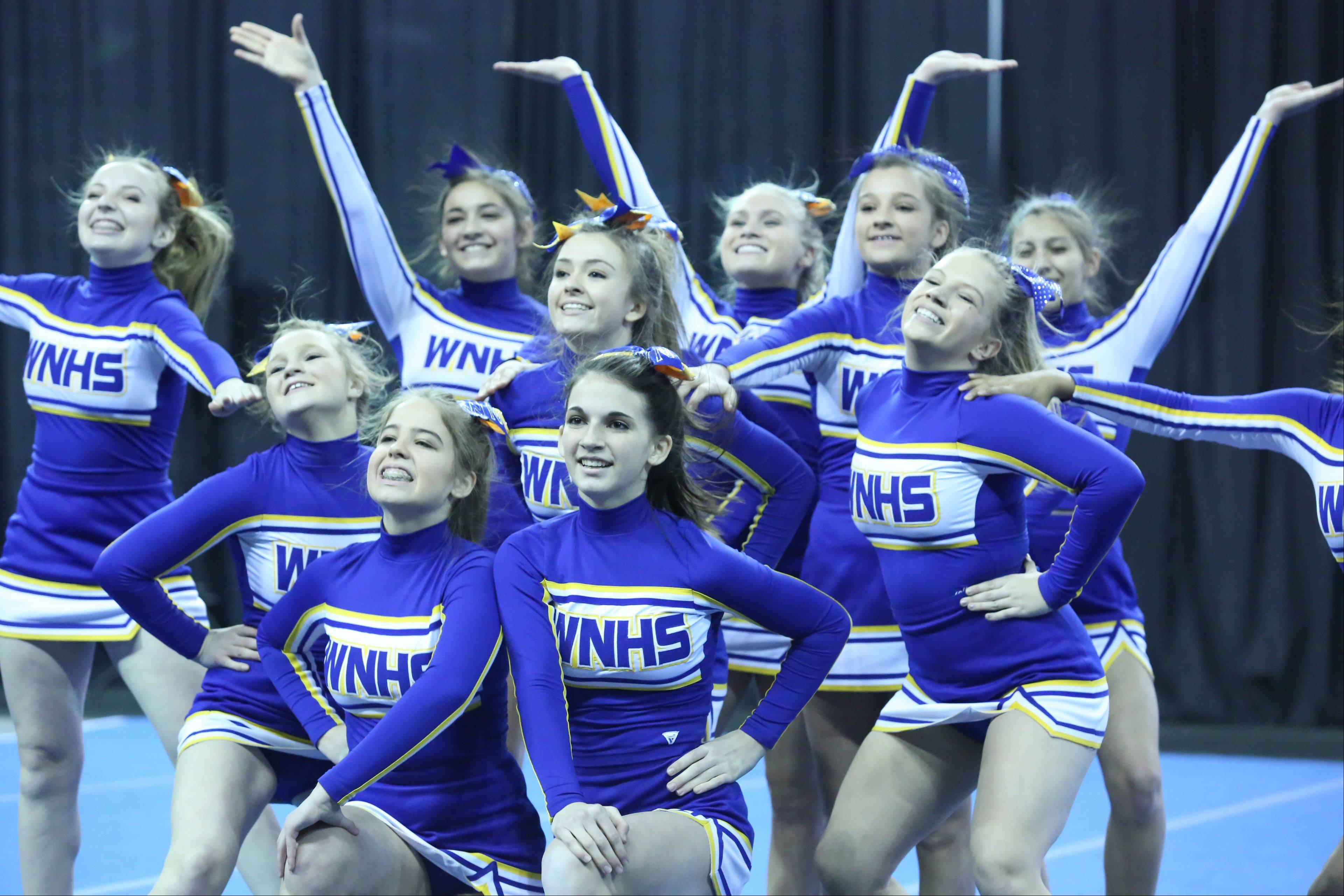 The Wheaton North High School cheer team competes in the IHSA Winter Meltdown Cheerleading and Dance Competition at Sears Centre Arena on Saturday in Hoffman Estates.