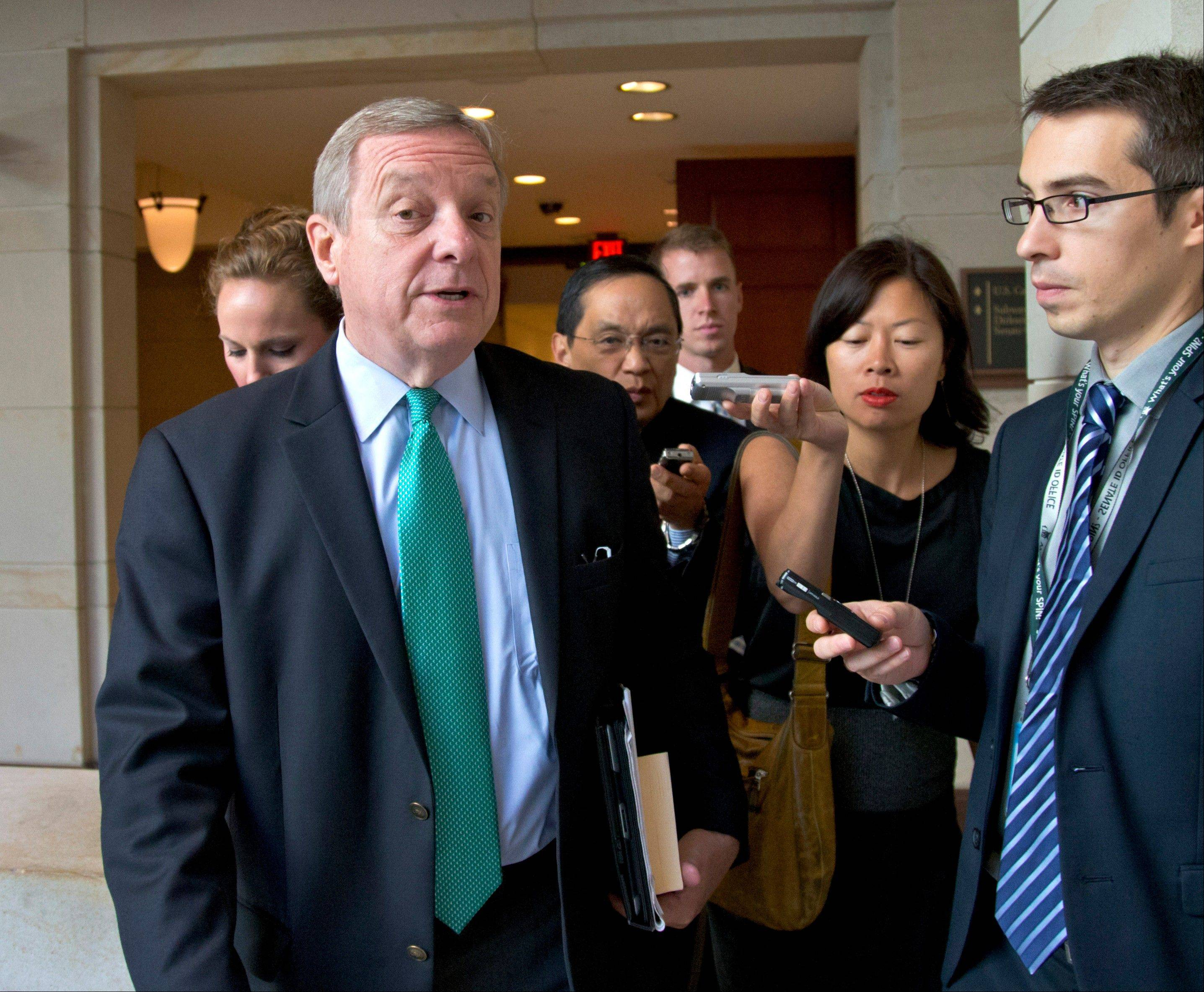 Illinois Sen. Dick Durbin, the Senate assistant Democratic majority leader, walks at the Capitol in Washington. An unusual alliance of tea party enthusiasts and liberal leaders in Congress is pursuing major changes in mandatory sentencing laws.