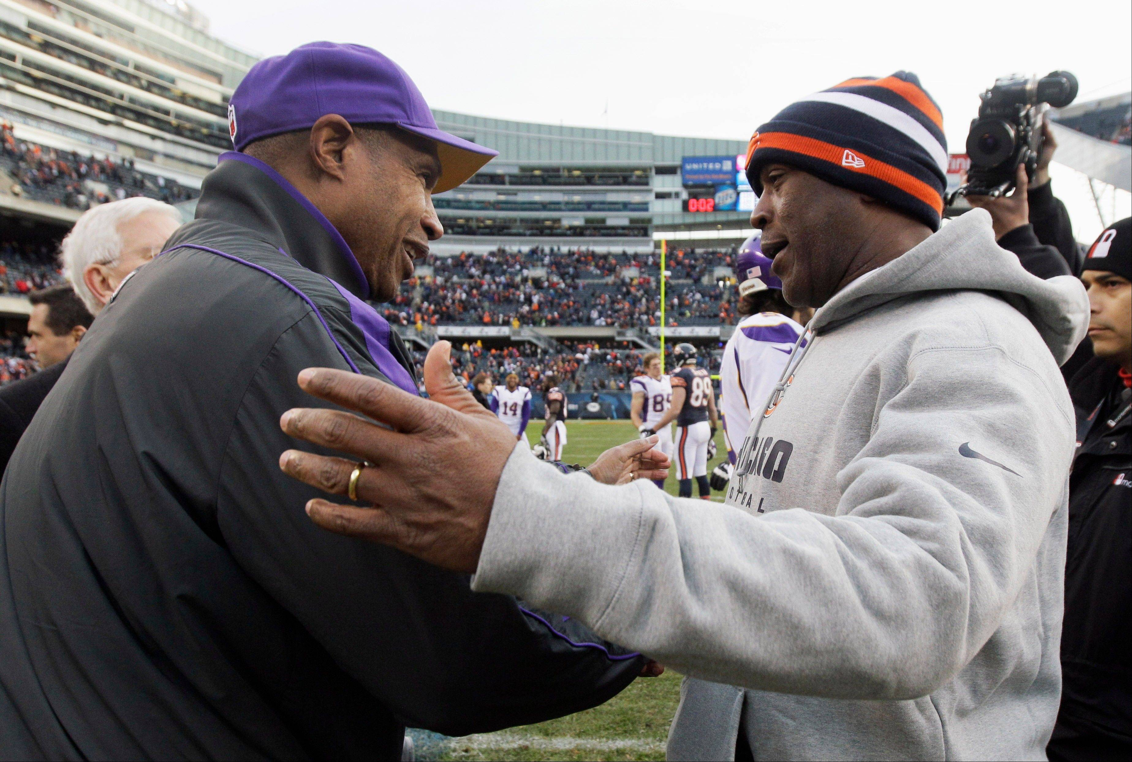 Former Bears coach Lovie Smith, right, is the new coach of the Tampa Bay Buccaneers, and former Vikings coach Leslie Frazier, left, reportedly will be his defensive coordinator.