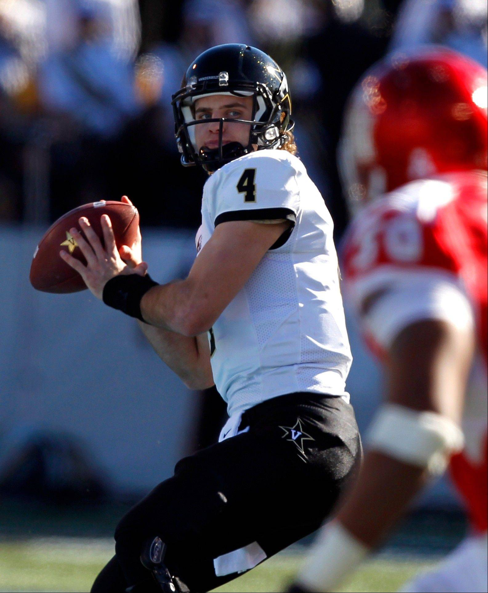 Vanderbilt quarterback Patton Robinette (4) throws a pass down field against Houston during the Compass Bowl Saturday in Alabama.