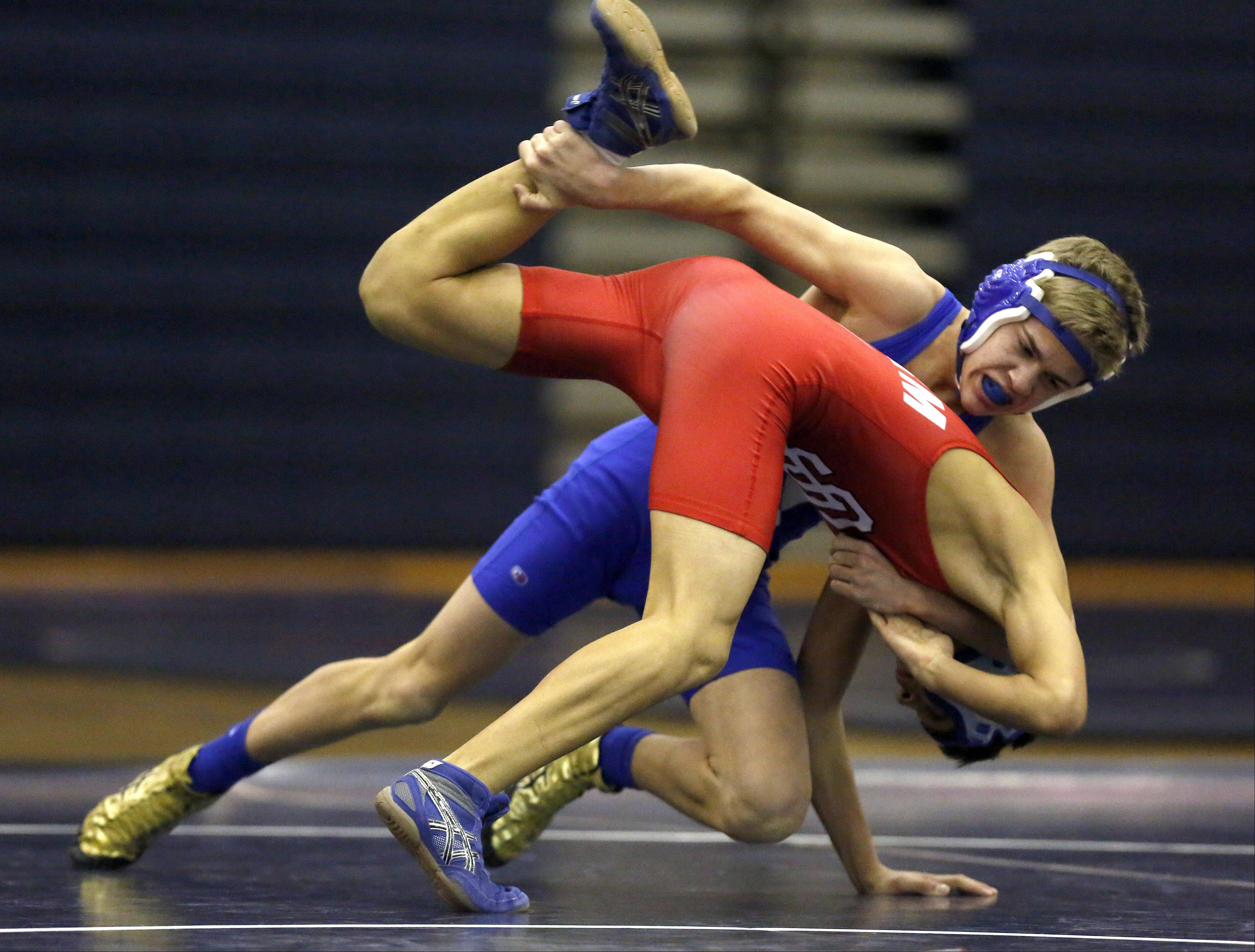 South Elgin�s Jordan Hoke-Ruiz and Geneva�s Nick Anderson battle at the 120 weight class during wrestling at South Elgin Saturday.