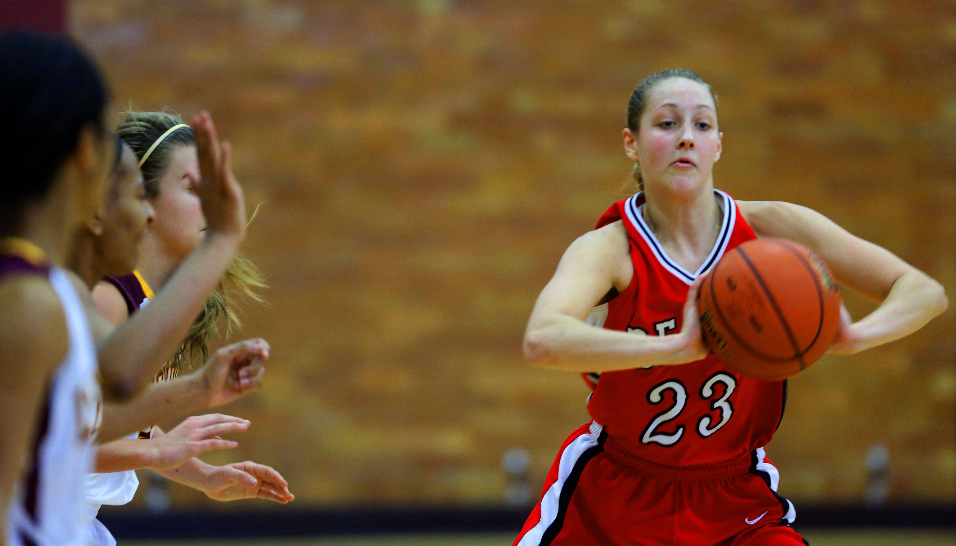 Benet�s Emily Eshoo passes around the Lockport defense during girls basketball action.