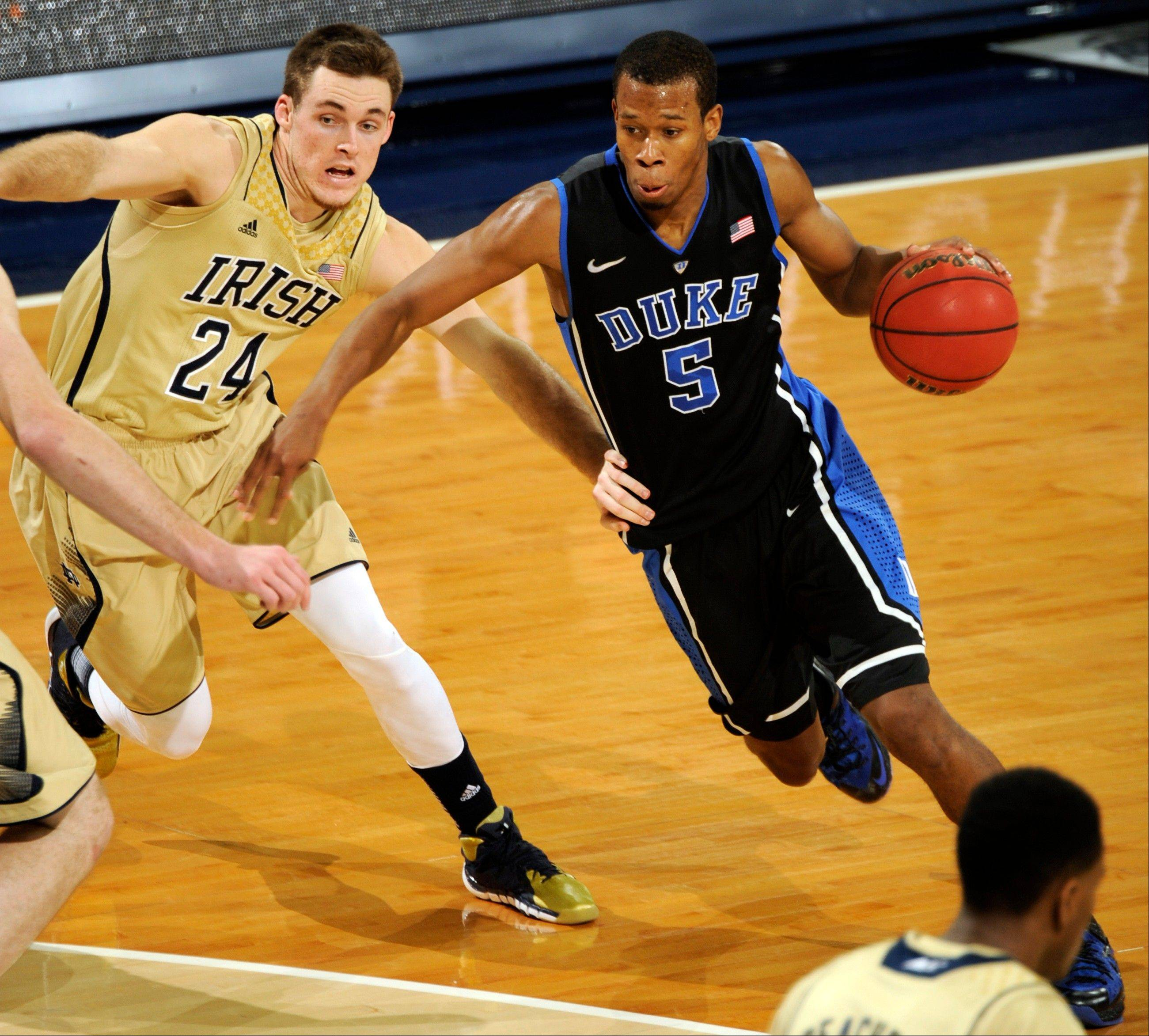 Duke guard Rodney Hood, right, drives the lane as Notre Dame guard Pat Connaughton defends the first half of an NCAA college basketball game, Saturday, Jan. 4, 2014, in South Bend, Ind. (AP Photo/Joe Raymond)
