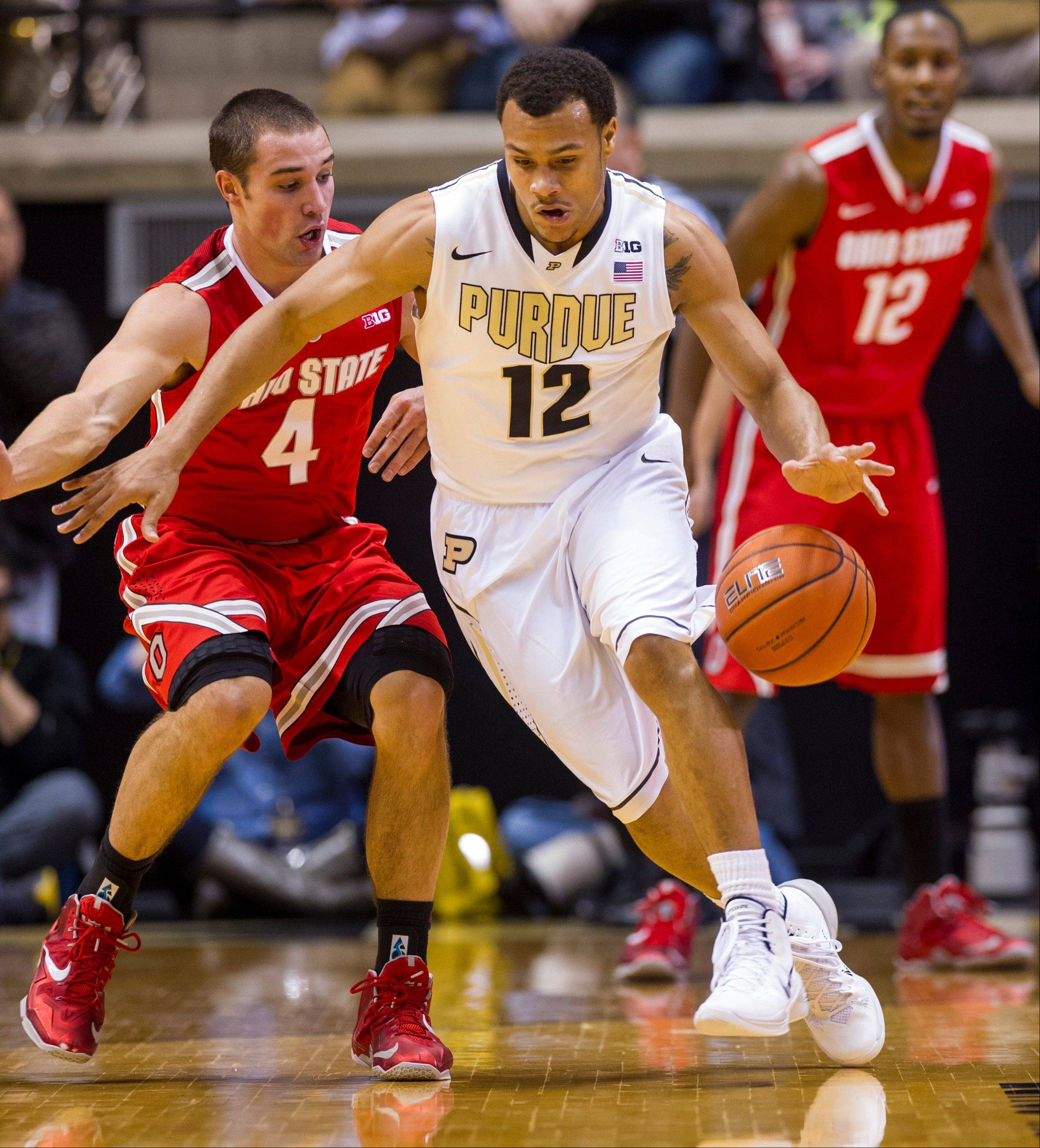 Purdue's Bryson Scott (12) works to maintain control of the ball as Ohio State's Aaron Craft (4) pressures him at mid-court in the first half of an NCAA college basketball game, Tuesday, Dec. 31, 2013, in West Lafayette, Ind. (AP Photo/Doug McSchooler)