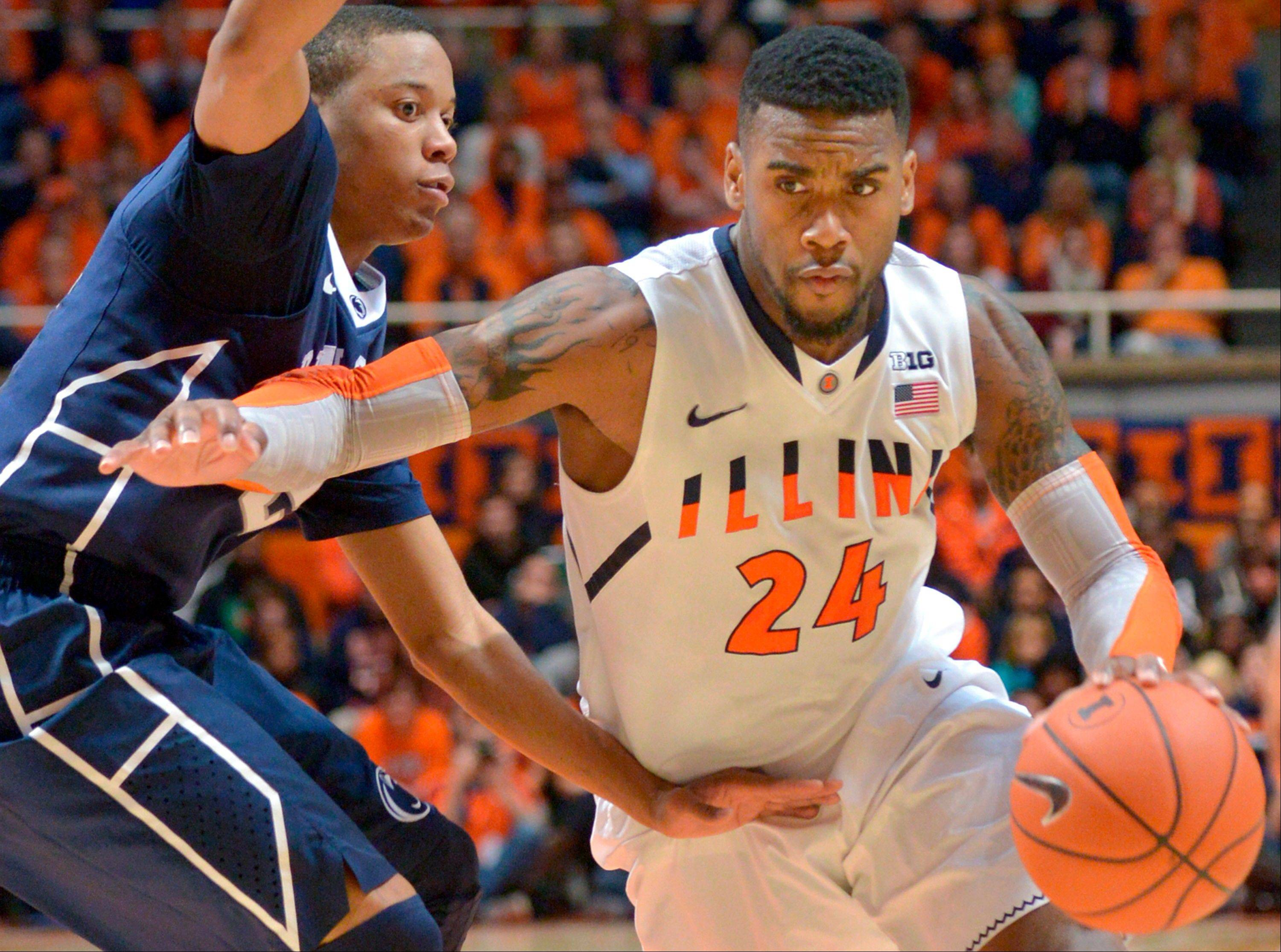 Illinois' Rayvonte Rice (24) drives past Penn State's Tim Frazier during an NCAA college basketball game at the State Farm Center in Champaign, Ill., on Saturday, Jan. 4, 2014. (AP Photo/Robin Scholz)