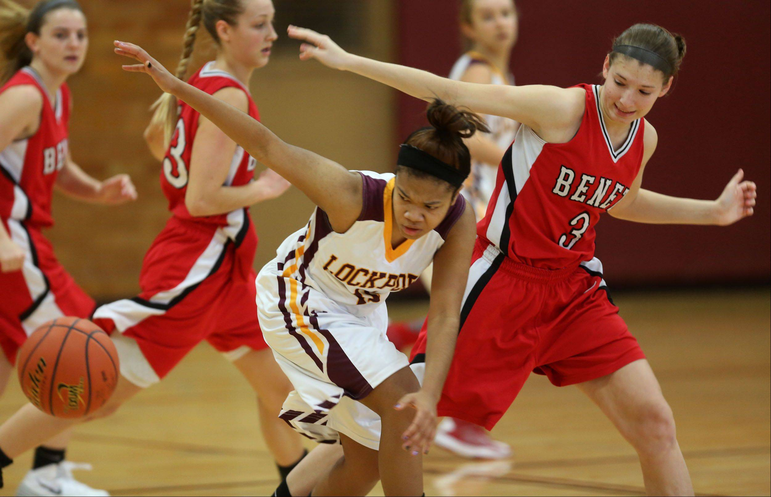 Benet�s Emma Hlavin, right, eyes the ball against Lockport during girls basketball action.