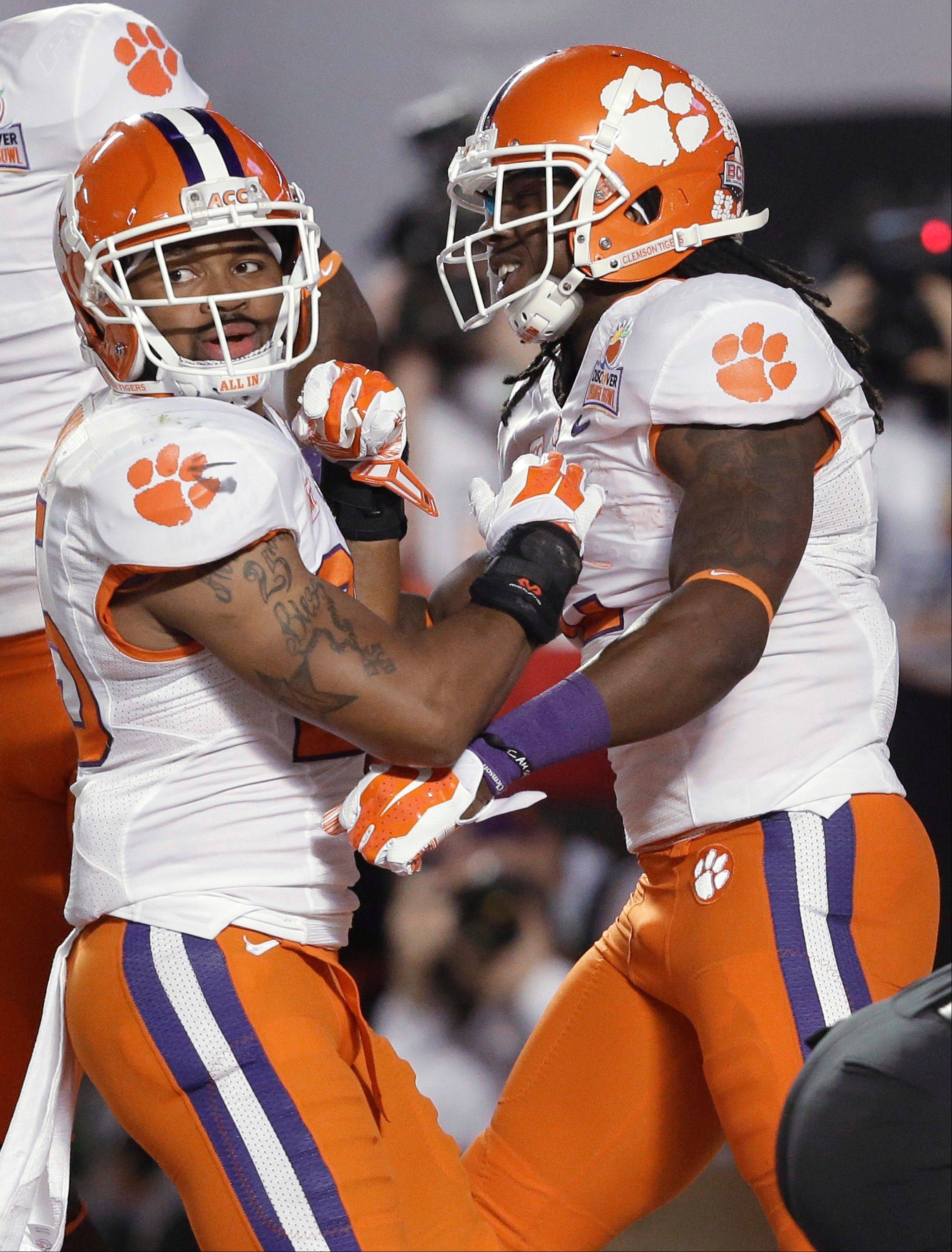 Clemson wide receiver Sammy Watkins, right, is congratulated by running back Roderick McDowell after scoring a touchdown during the Orange Bowl against Ohio State in Miami Gardens, Fla.