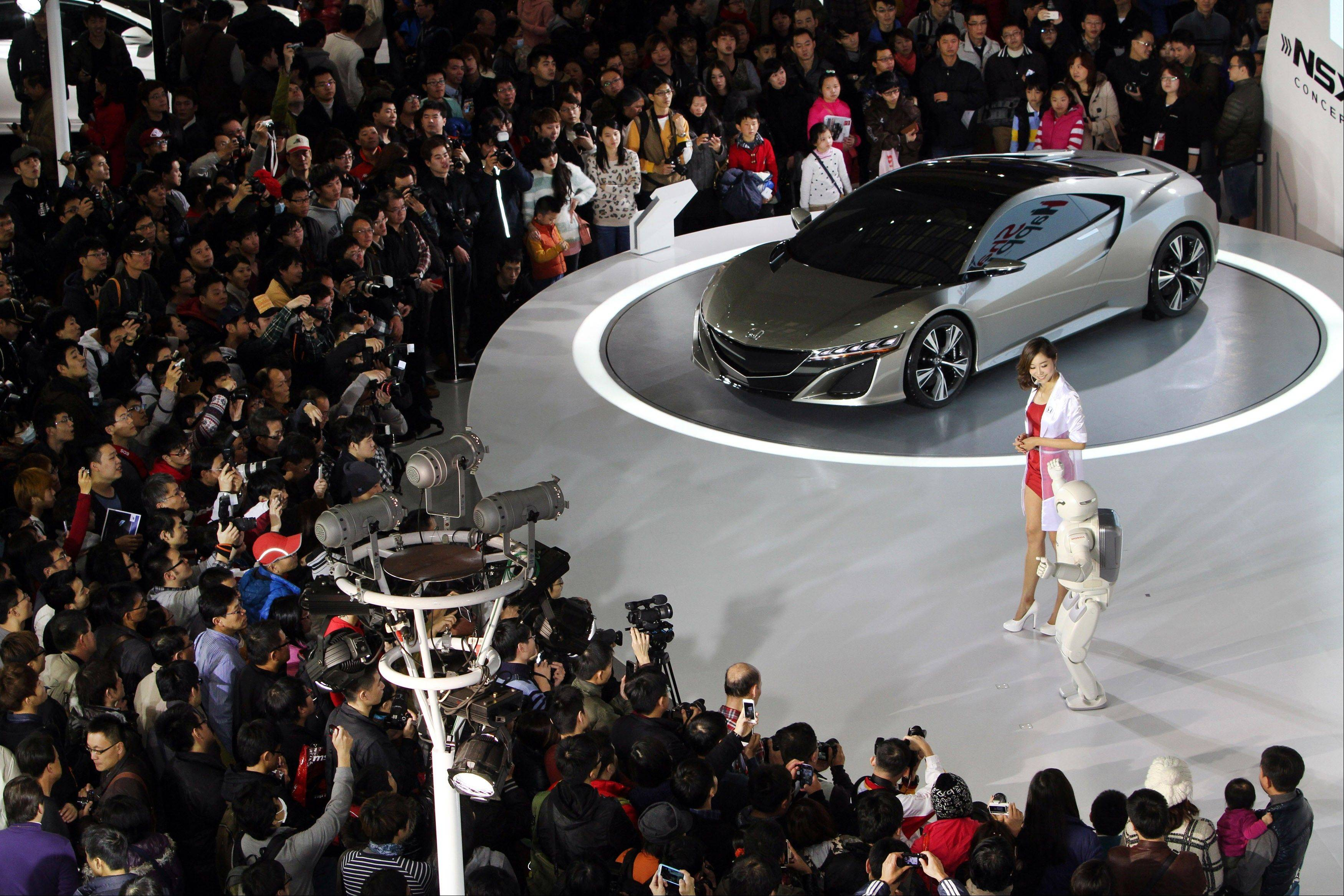 Visitors gather around Honda NSX Concept I on display during the Taipei International Auto Show Sunday at the Taipei World Trade Center in Taipei, Taiwan.