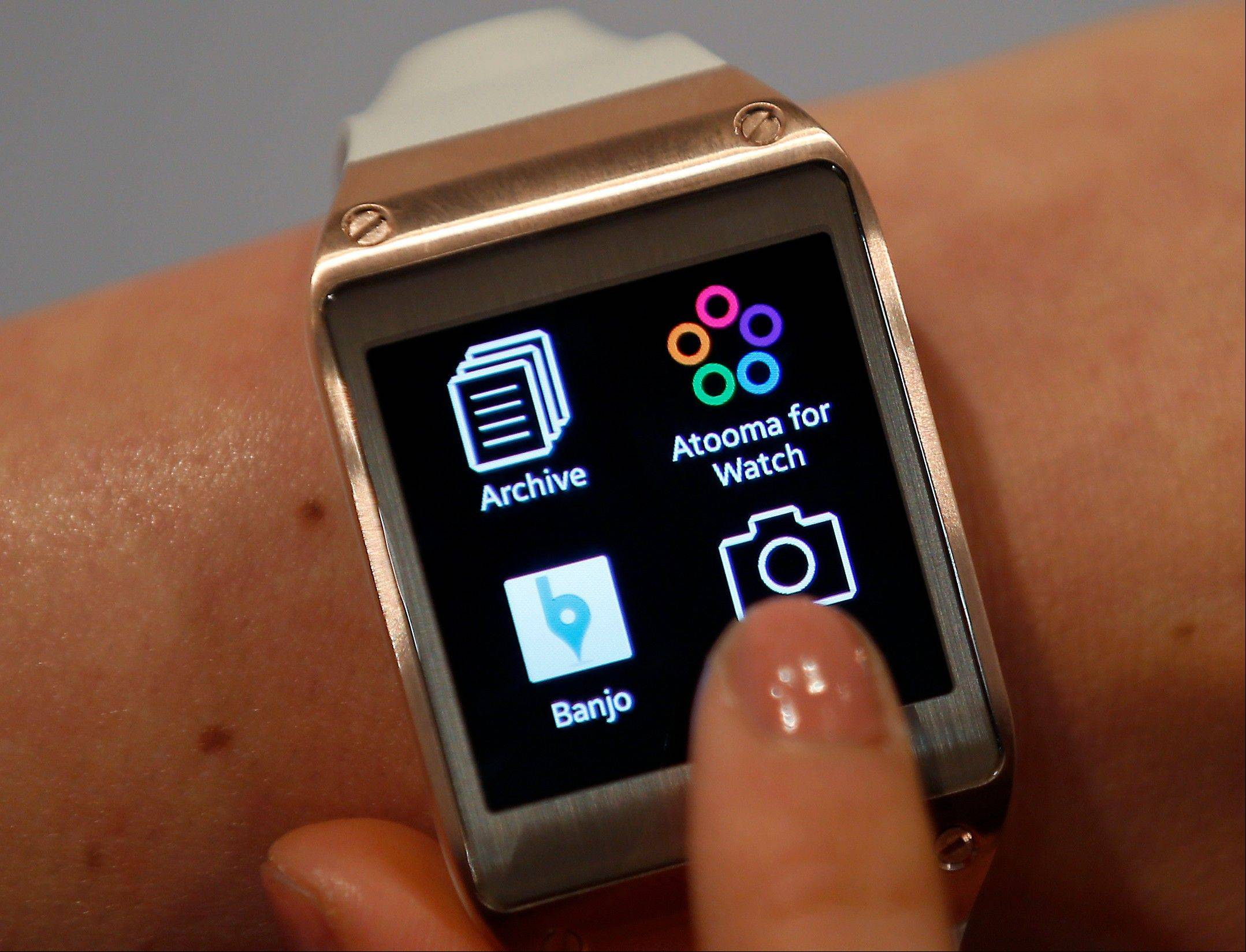 A model touches the screen of a Samsung Galaxy Gear smartwatch in Berlin, Germany. The so-called smartwatch is what some technology analysts believe could become this year's must-have holiday gift.
