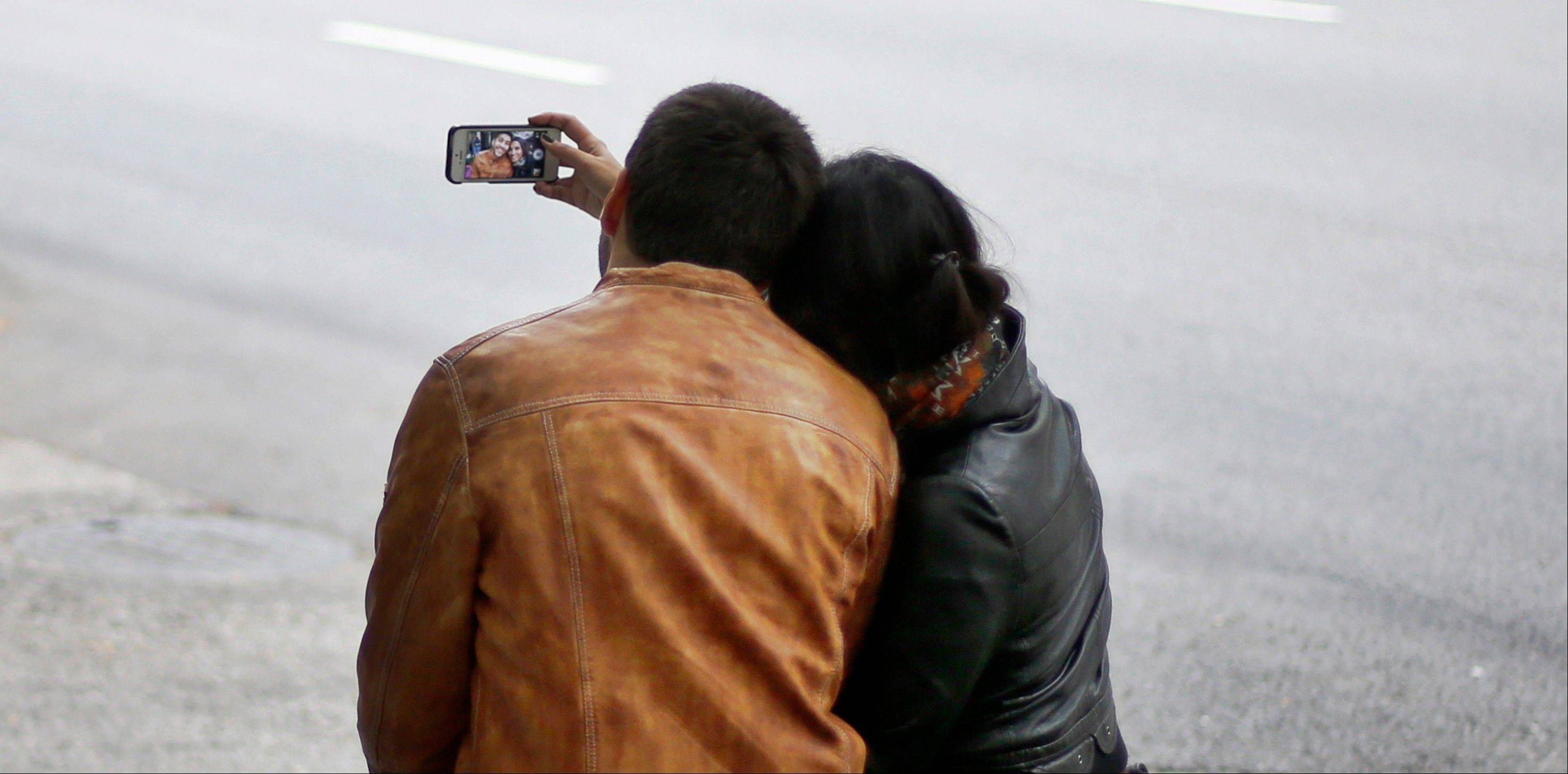 Serkan Ozsarac uses his cellphone camera with girlfriend Beyza Buyuker in Chicago. Competition is more intense than ever in the camera phone market, which means consumers have more choices than ever.