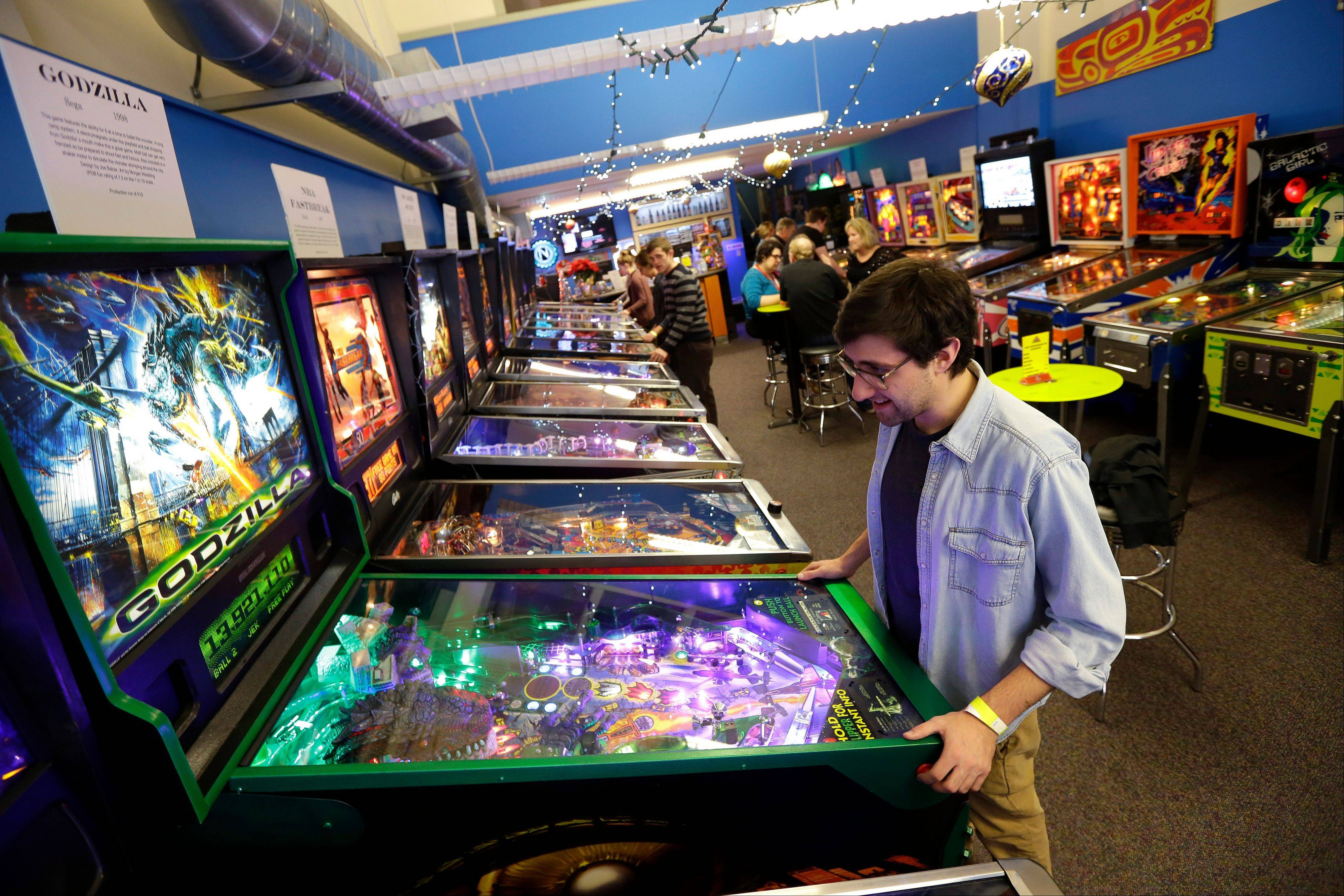 Josh Saitelbach plays pinball on an 1998 Godzilla machine as he visits the Seattle Pinball Museum in Seattle. The museum allows visitors who pay the admission fee to play unlimited rounds on the machines, which range from the 1960s to modern-day games.