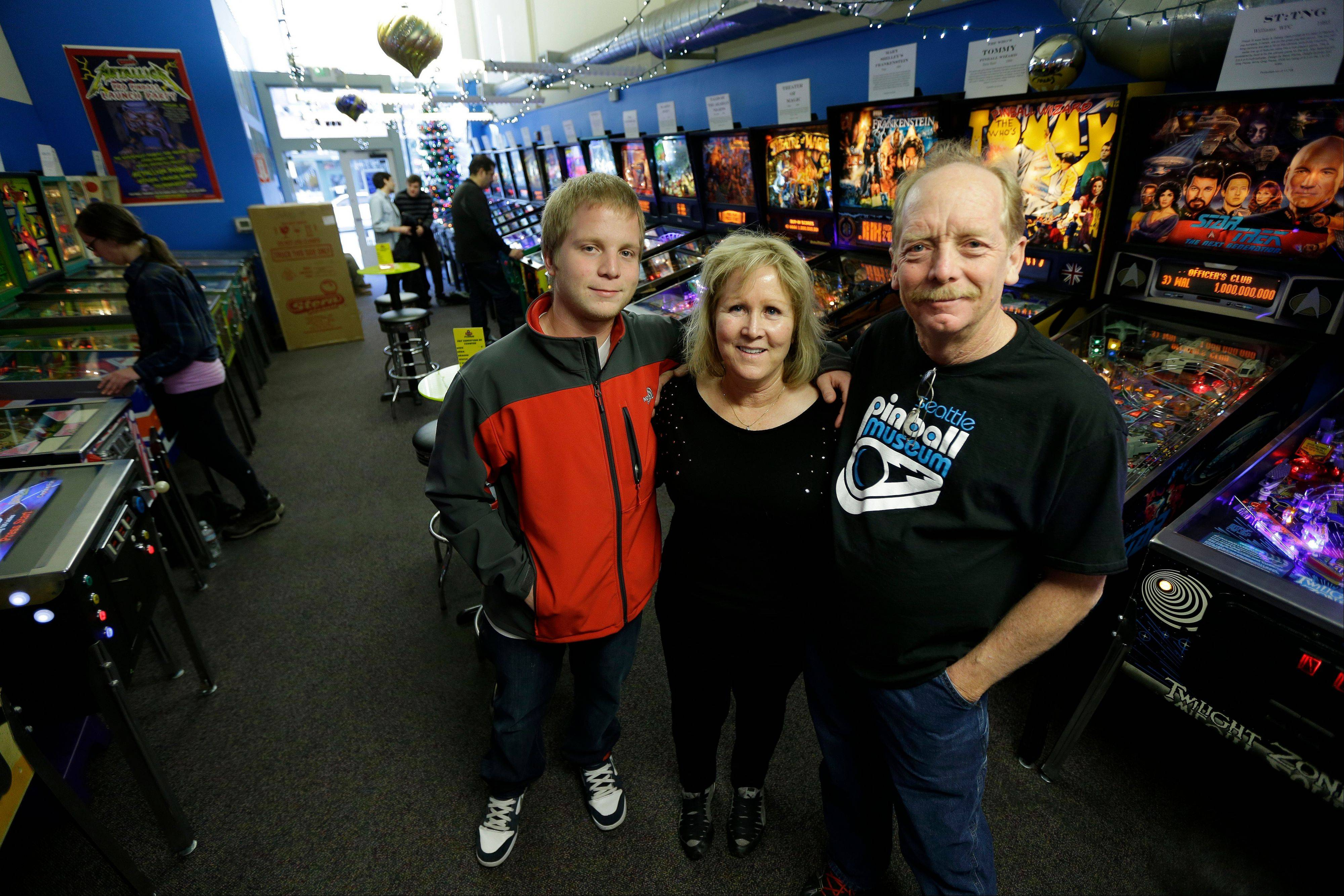 Charles Martin, right, his wife, Cindy and their son Michael, own and operate the Seattle Pinball Museum.