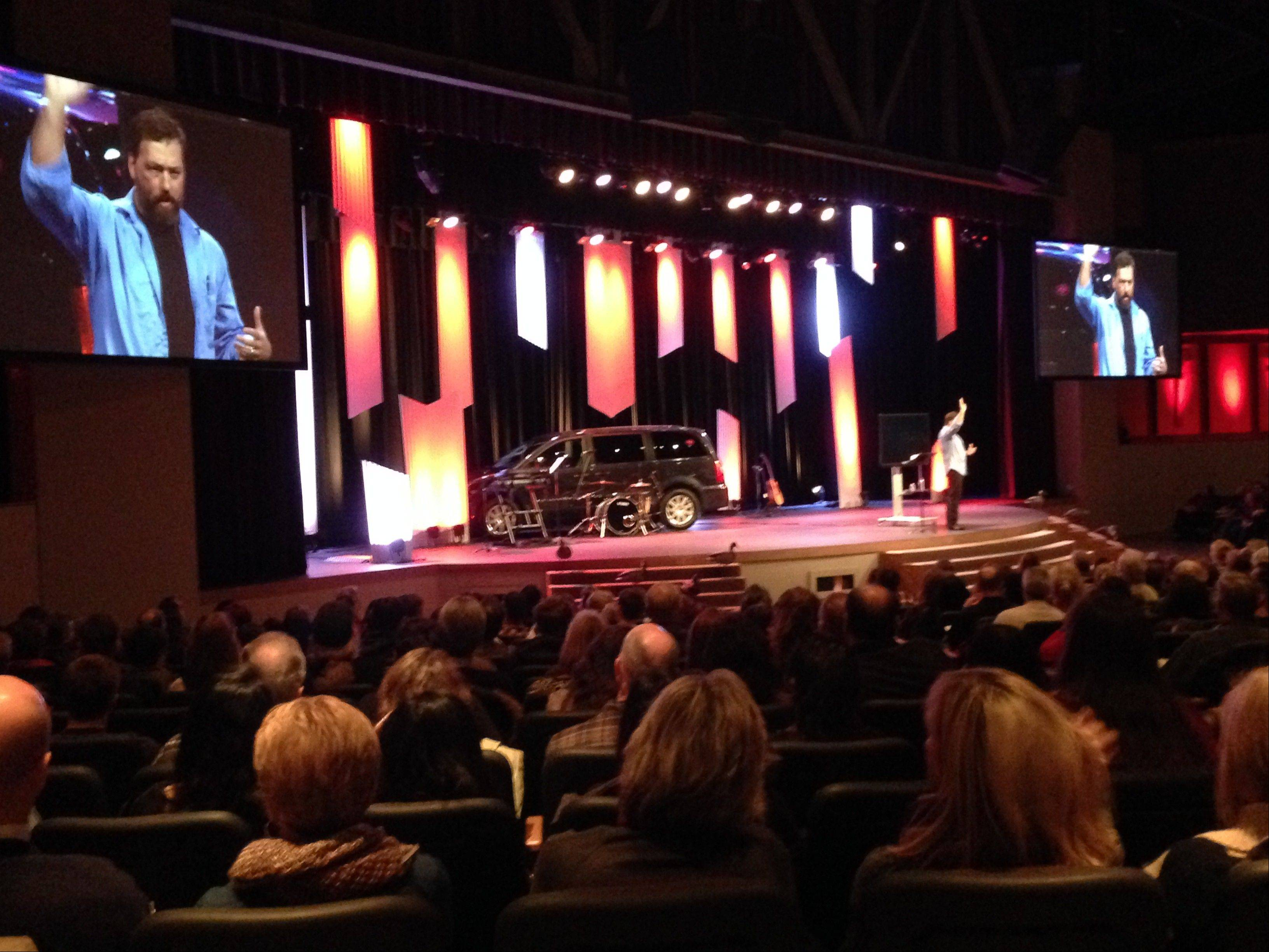 """Duck Dynasty"" star Alan Robertson speaks to a packed house Saturday night at Compass Church in Naperville."