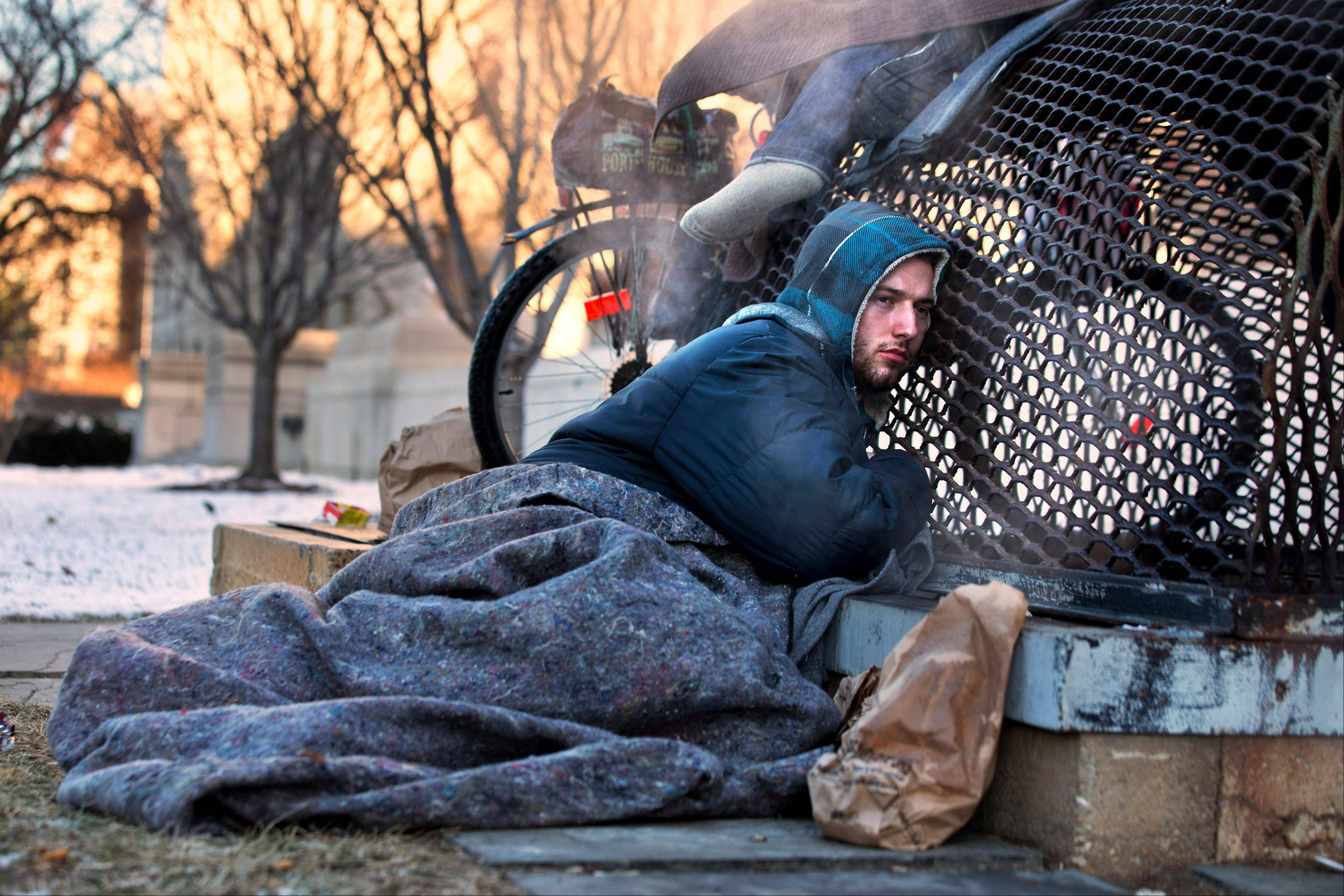 Nick warms himself Saturday on a steam grate with three other homeless men by the Federal Trade Commission, just blocks from the Capitol, during frigid temperatures in Washington4. A winter storm that swept across the Midwest this week blew through the Northeast on Friday, leaving bone-chilling cold in its wake.