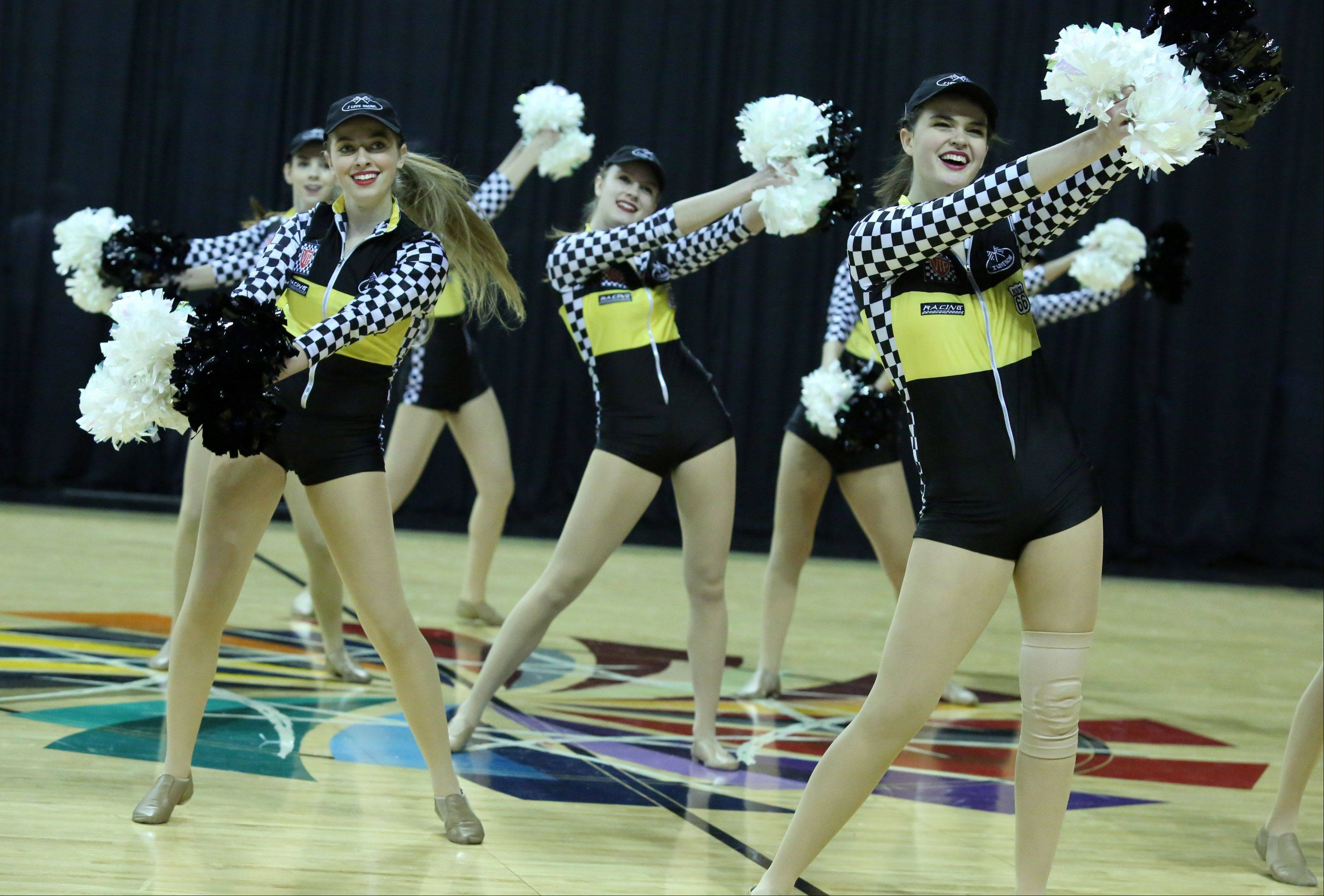 The Elk Grove High School dance team competes in the IHSA Winter Meltdown Cheerleading and Dance Competition at Sears Centre Arena on Saturday in Hoffman Estates.