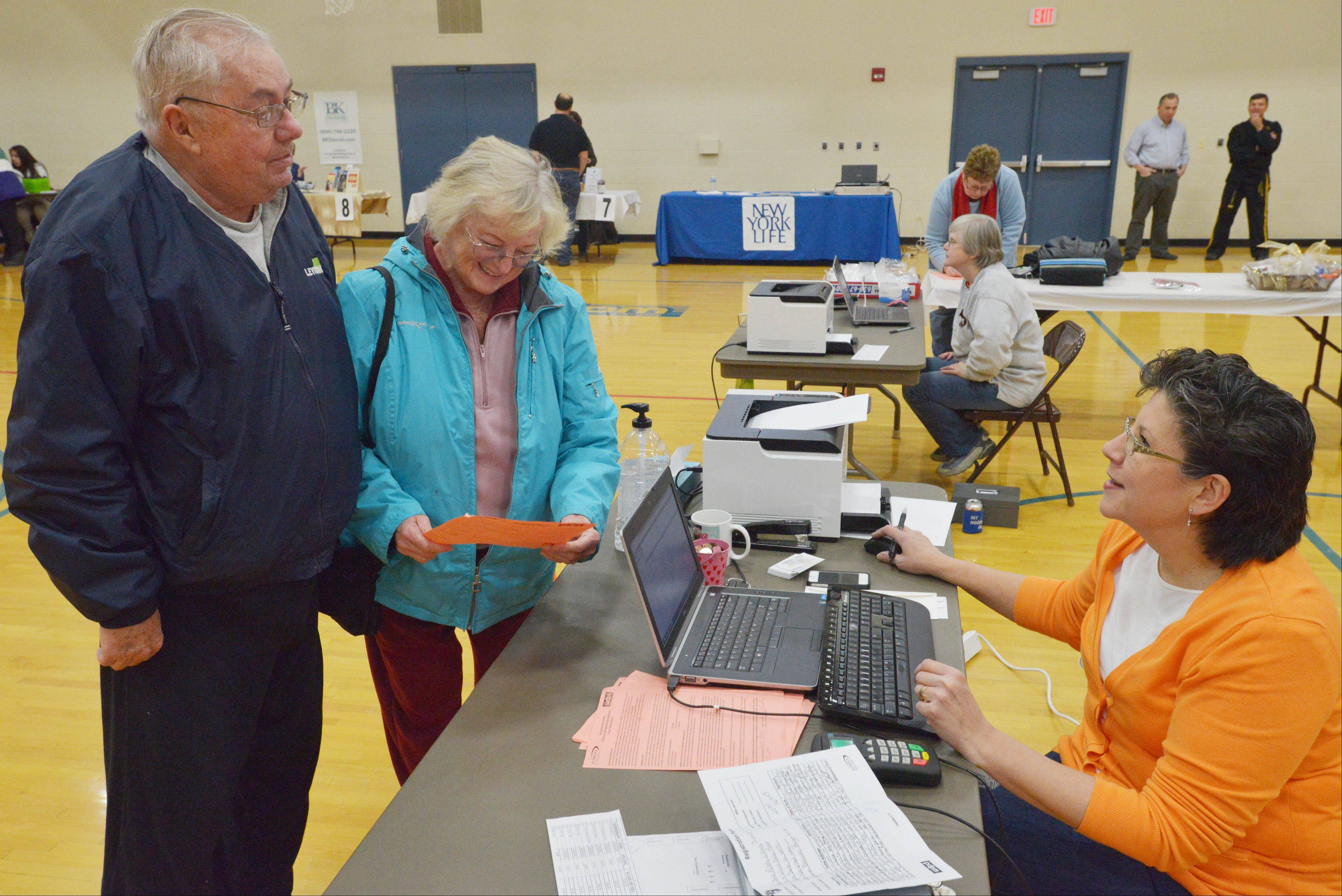 Fred and Ruth Pruim of Wood Dale sign up for the heath club during the health and resource fair at the Wood Dale Park District building Saturday. They were being helped by Linda Bray of the health club.