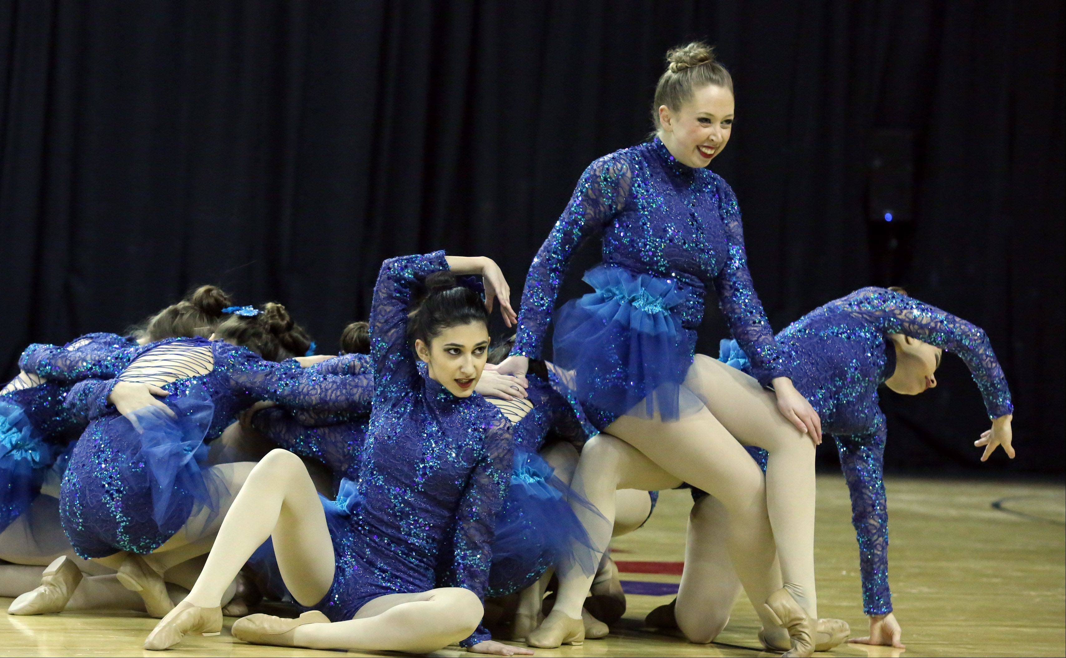 Aurora Central High School dance team competes in the IHSA Winter Meltdown Cheerleading and Dance Competition at Sears Centre Arena on Saturday in Hoffman Estates.