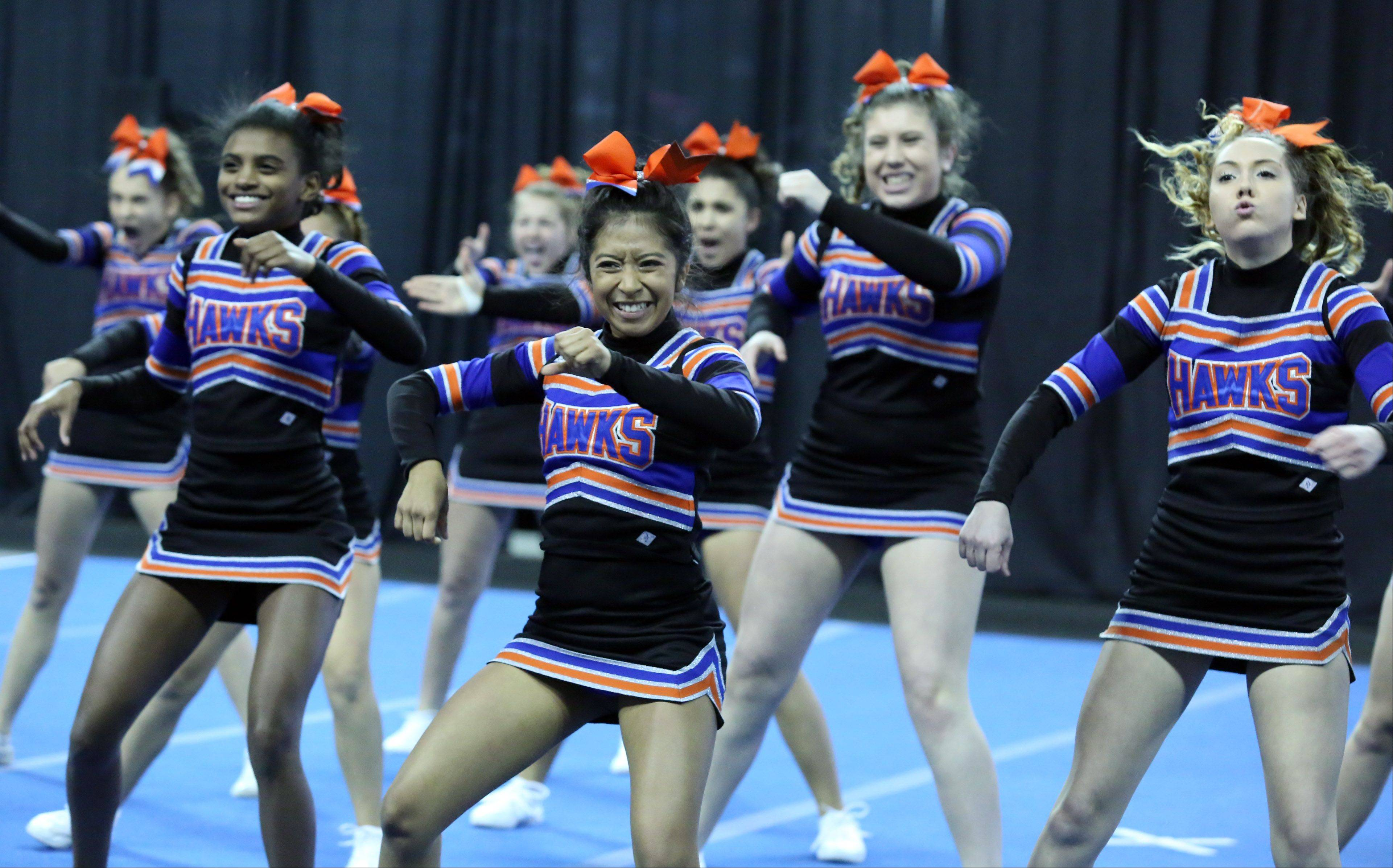 Hoffman Estates High School junior varsity cheer team competes in the IHSA Winter Meltdown Cheerleading and Dance Competition at Sears Centre Arena on Saturday in Hoffman Estates.